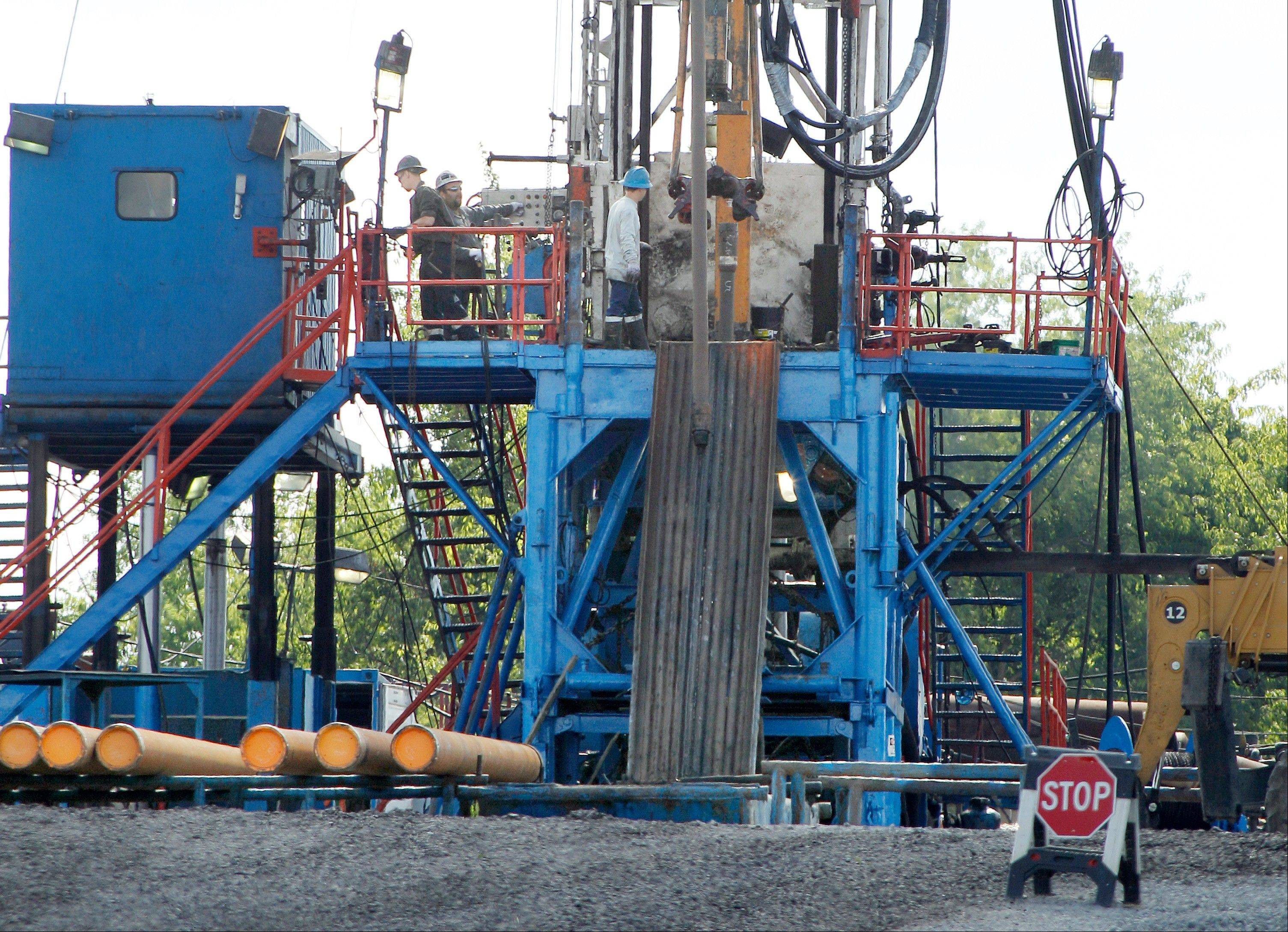 A crew works on a drilling rig at a well site for shale based natural gas in Zelienople, Pa. .S. consumer prices rose slightly in May 2013, as higher energy costs were partly offset by cheaper food.