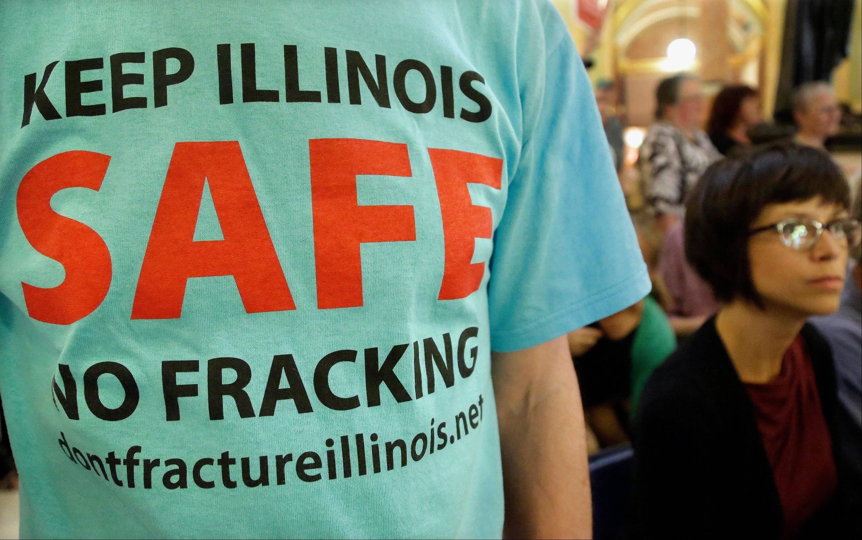 "Aprotester attends a rally after a House Committee hearing on oil drilling, ""fracking"" legislation at the Illinois State Capitol in Springfield in May."