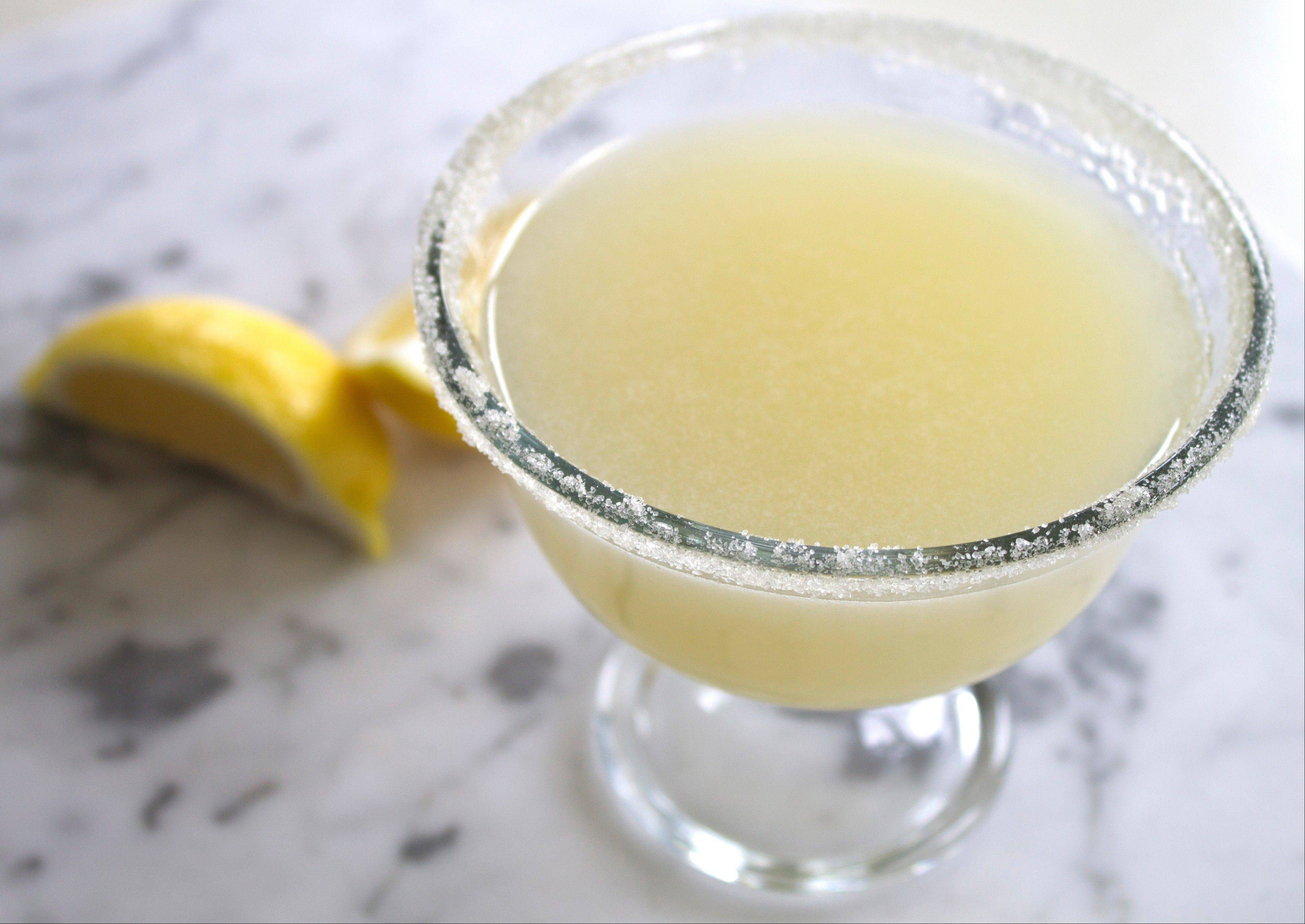 Juice from broiled lemons adds unique flavor notes to a margarita.