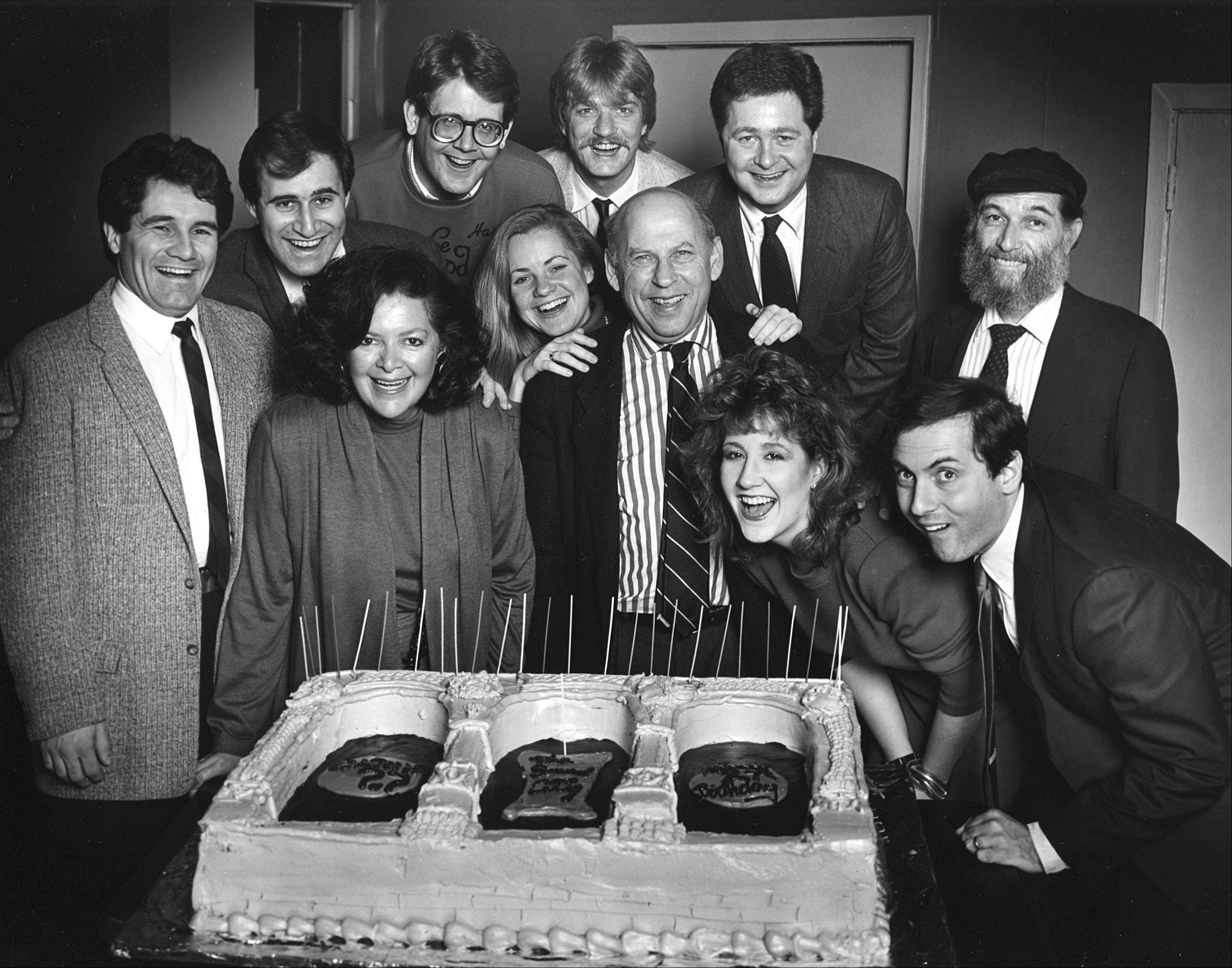 "Bernard Sahlins, co-founder of The Second City, poses with actors during an opening night party in Chicago. Sahlins, who nurtured the early careers of many of the earliest stars of ""Saturday Night Live,"" died Sunday at the age of 90. In the back row are: Rick Hall, Richard Kind, Harry Murphy, Craig Taylor, Jim Fay and Fred Kaz. In the front row are: Joyce Sloane, Bonnie Hunt, Sahlins, Maureen Kelly and Dan Castellaneta."