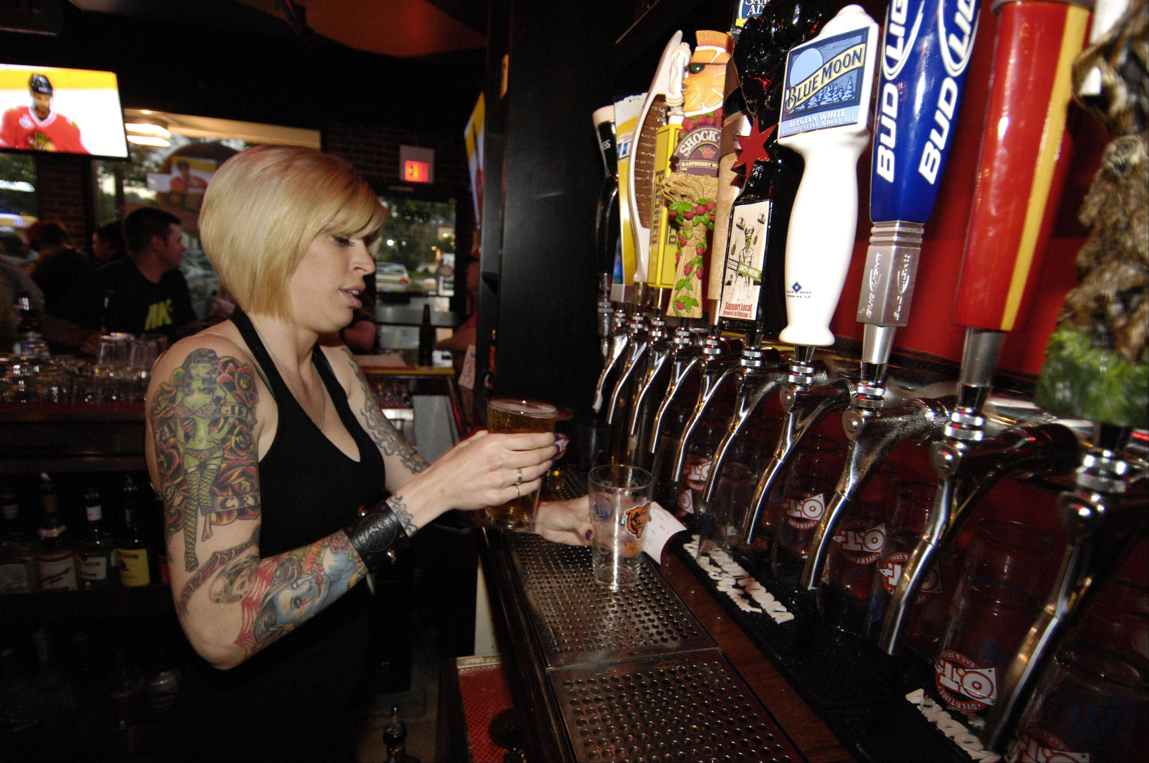 Miska Pifke pours beer at Overtime Bar & Grill in Lombard.