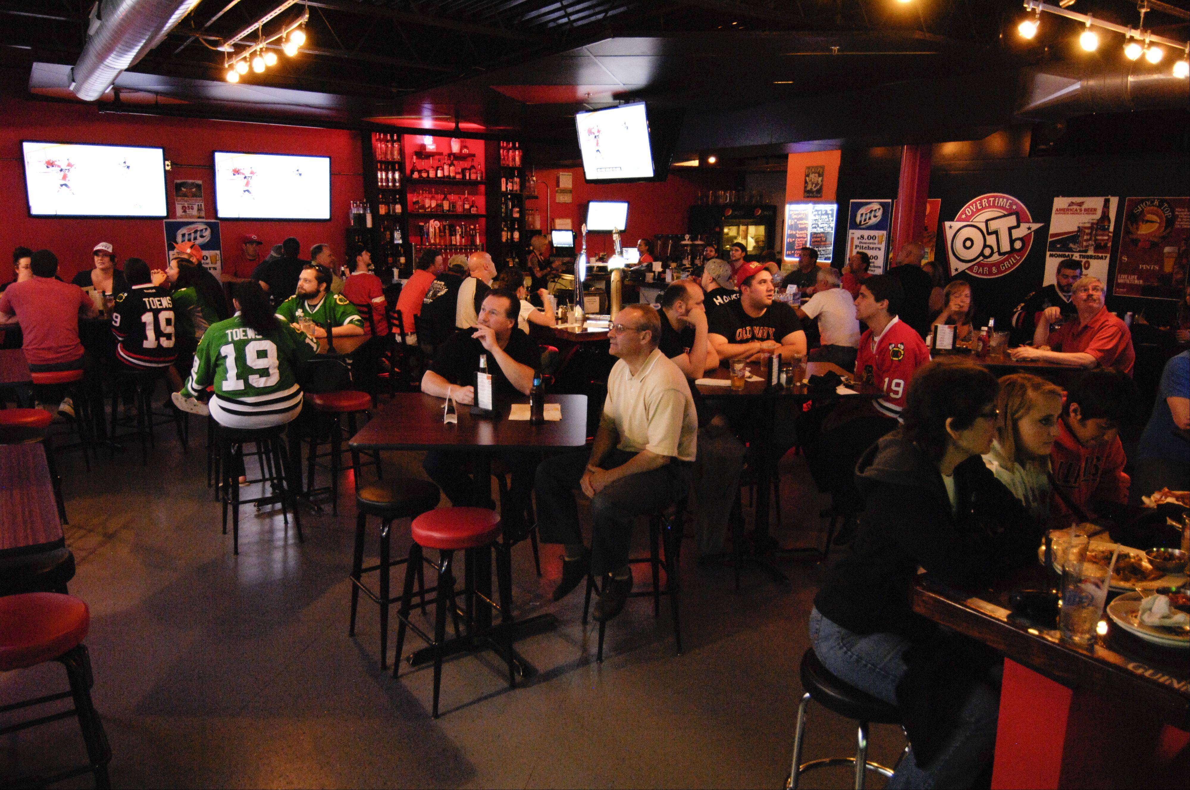Patrons watch the Chicago Blackhawks at Overtime Bar & Grill in Lombard.
