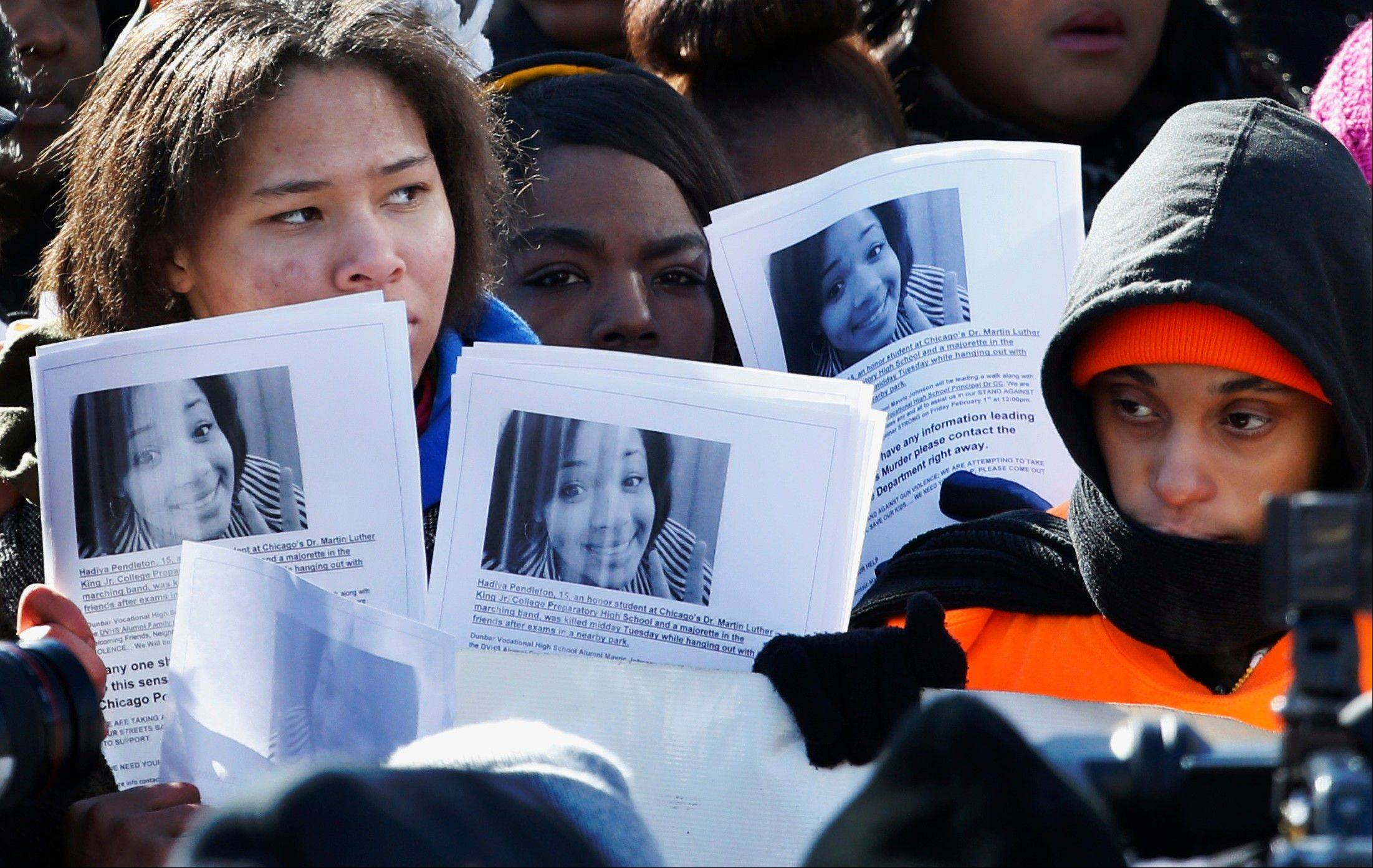 Protesters at an anti-gun violence rally Feb. 1 in Chicago hold up copied photos of 15-year-old Hadiya Pendleton, who was shot and killed Jan. 29 about a mile from President Barack Obama's home.