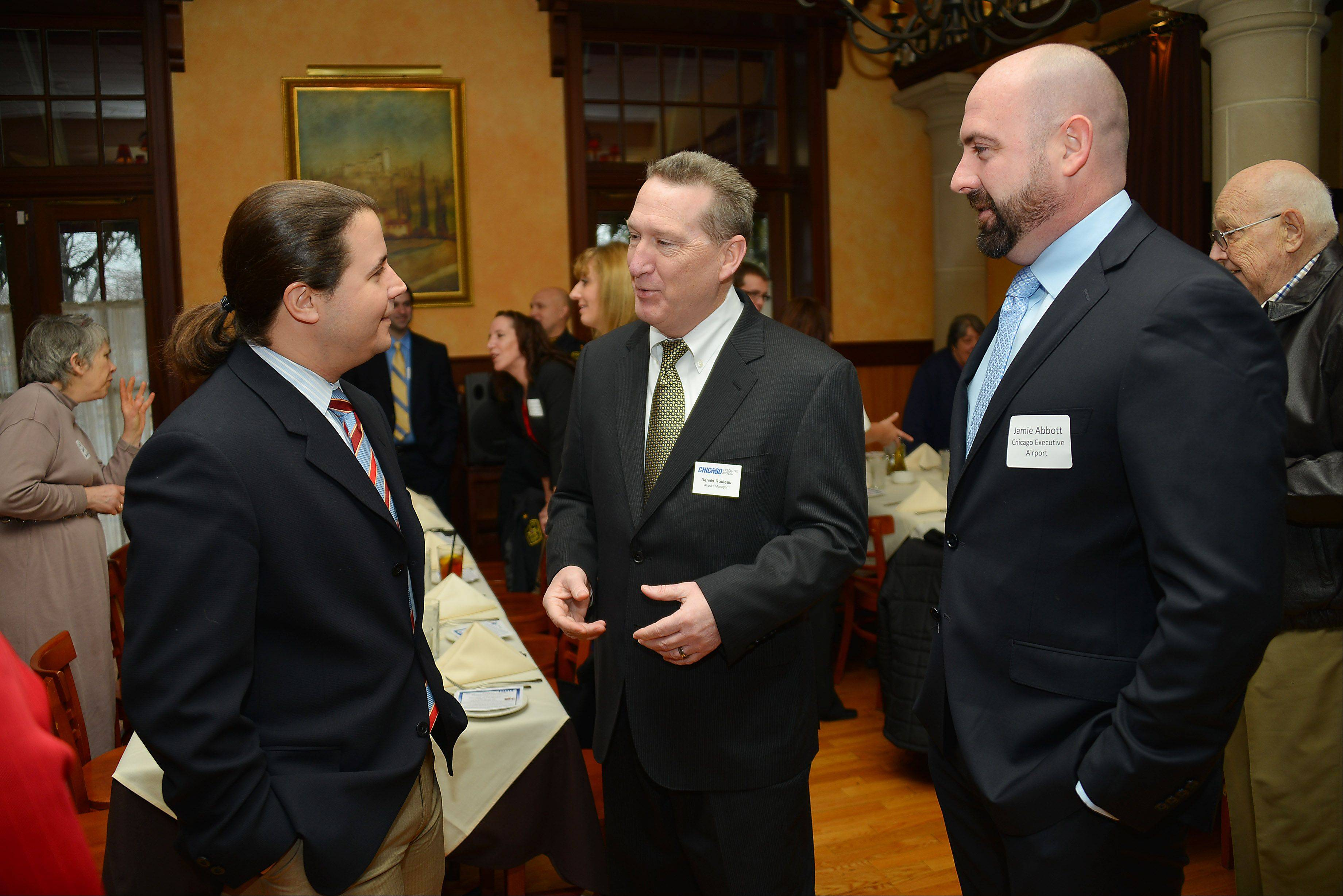 Dennis Rouleau, center, manager of Chicago Executive Airport, talks with Wheeling Village Manager Jon Sfondilis, left, and Jamie Abbott, assistant airport manager, at an event earlier this year. Abbott is taking over as acting manager while Rouleau is going on medical leave.