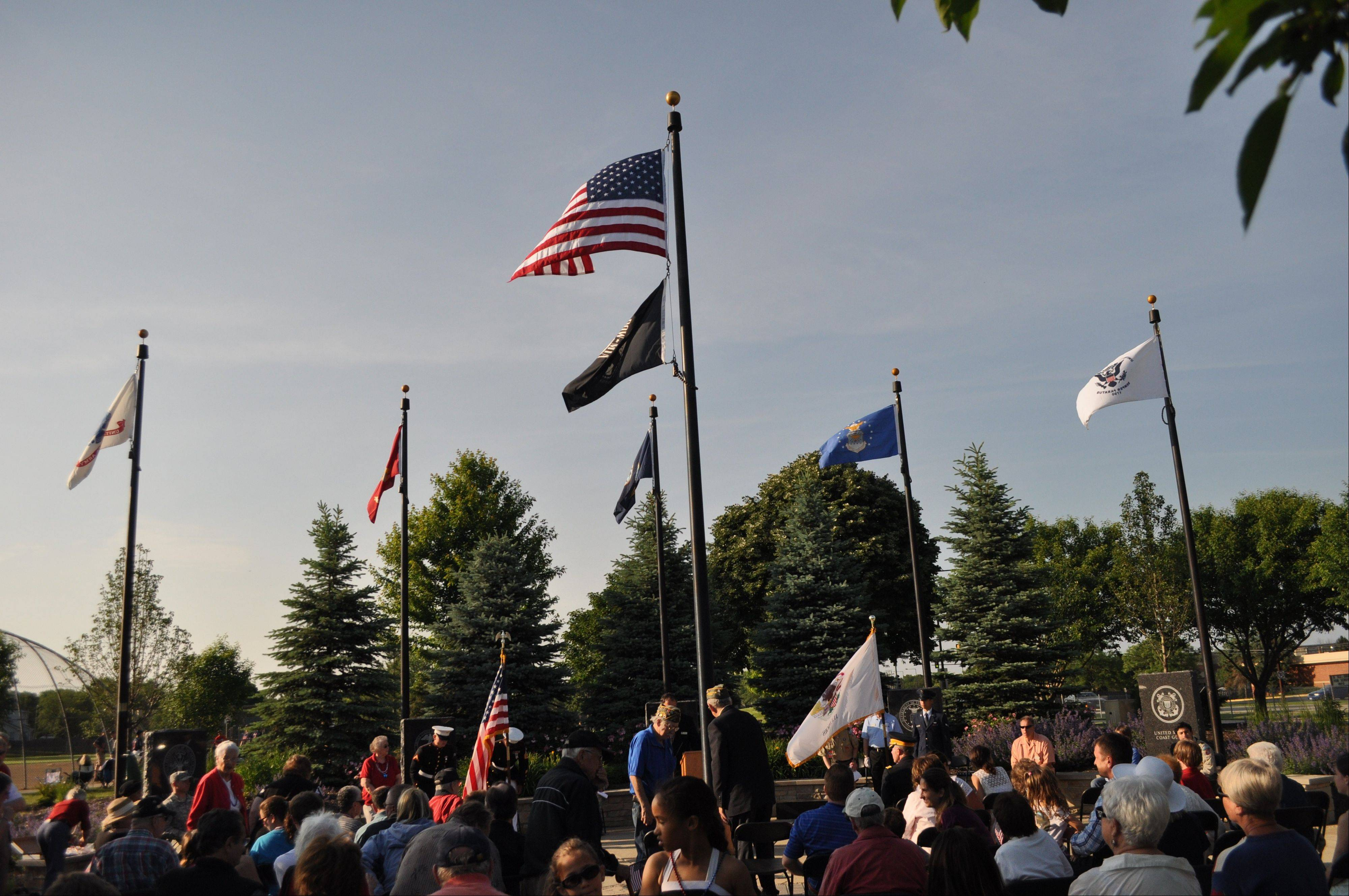 More than 100 people attended as members of the Armed Forces raised a flag for each of the five branches of the service at the Flag Day ceremonies held at Veterans Park in Buffalo Grove.
