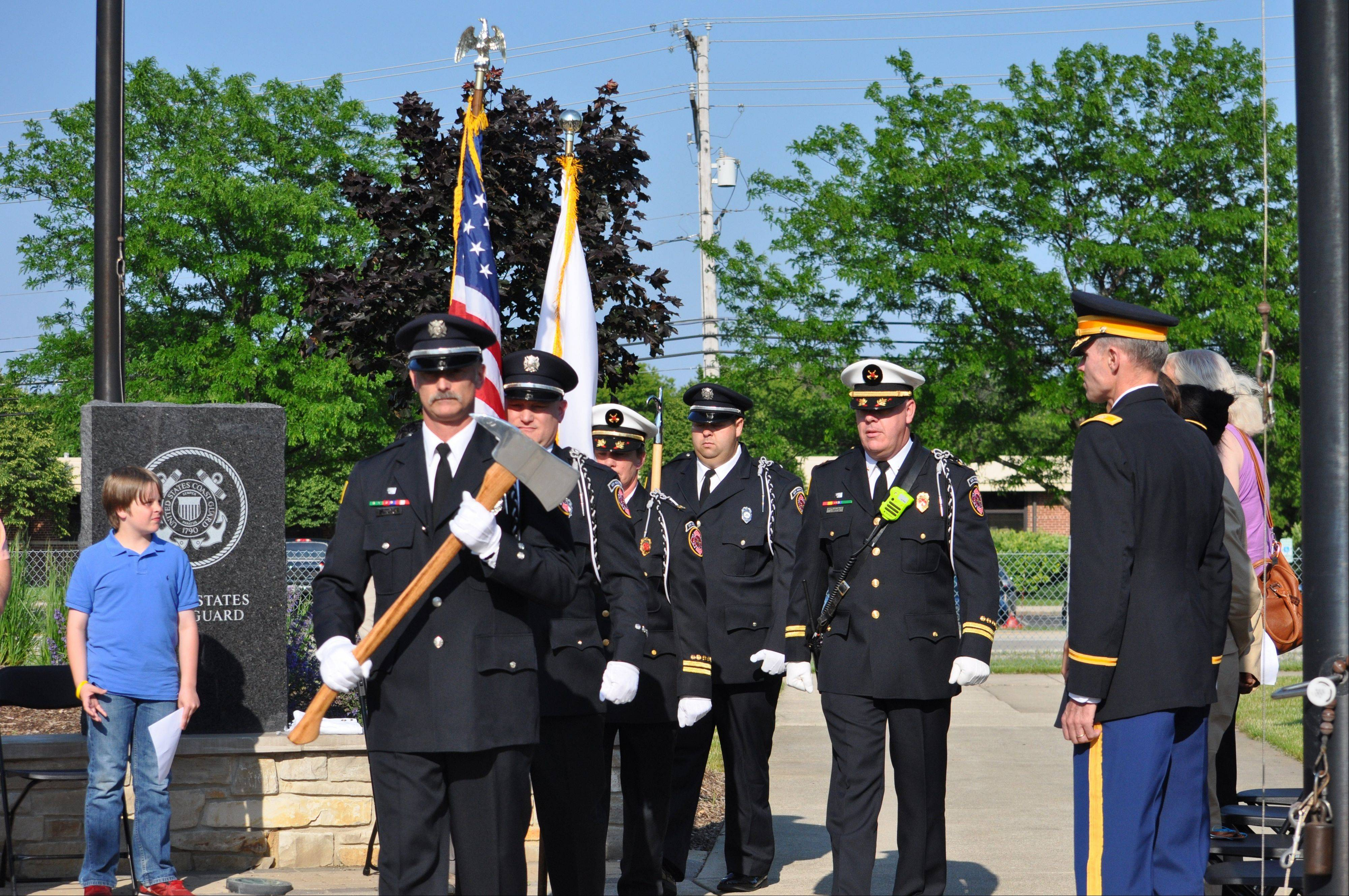 Members of the Buffalo Grove Fire Department Honor Guard participated in Flag Day ceremonies held Friday at Veterans Park, 1300 N. Weiland Road, Buffalo Grove.