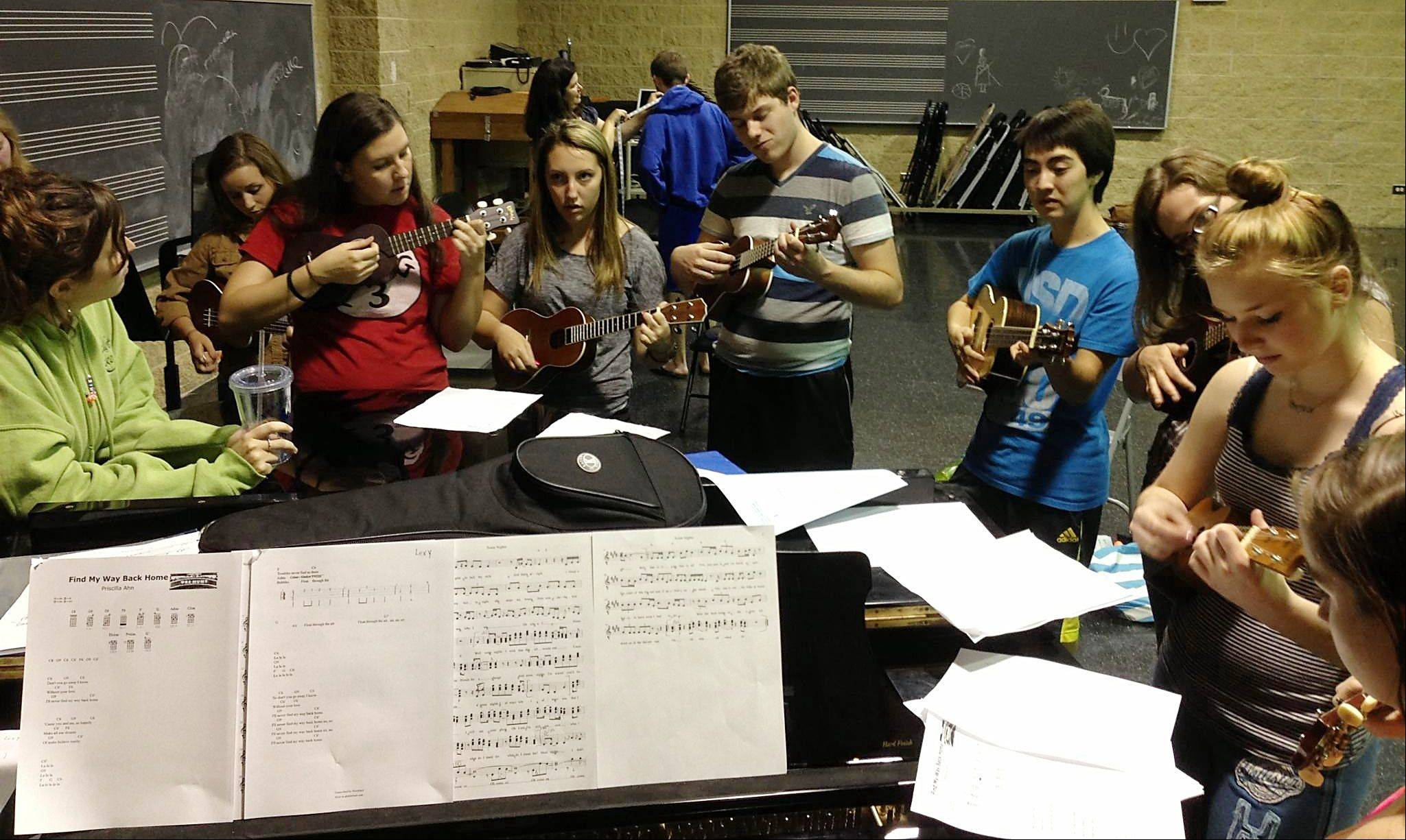 """iSing"" cast members rehearse a ukulele scene. From left are Izzy Romano, Mary Grace Martens, Taylor Edwards, Cameron Coffland, Ben Joyce, Logan Moring and Maddie Hayes."