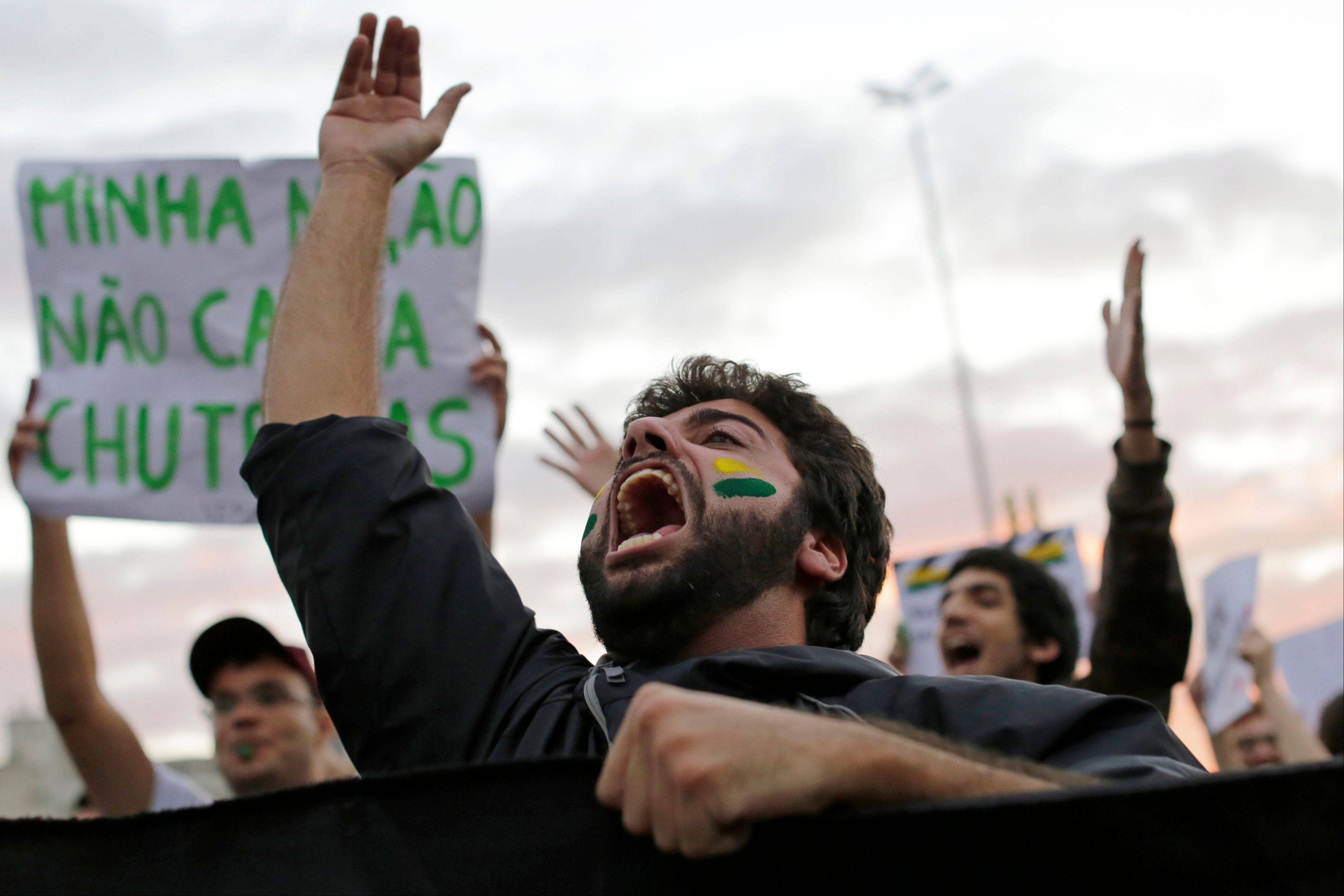 A demonstrator shouts during a protests in Sao Paulo, Brazil, Monday, June 17, 2013. Some of the biggest demonstrations since the end of Brazil's 1964-85 dictatorship have broken out across this continent-sized country, uniting tens of thousands frustrated by poor transportation, health services, education and security despite a heavy tax burden.