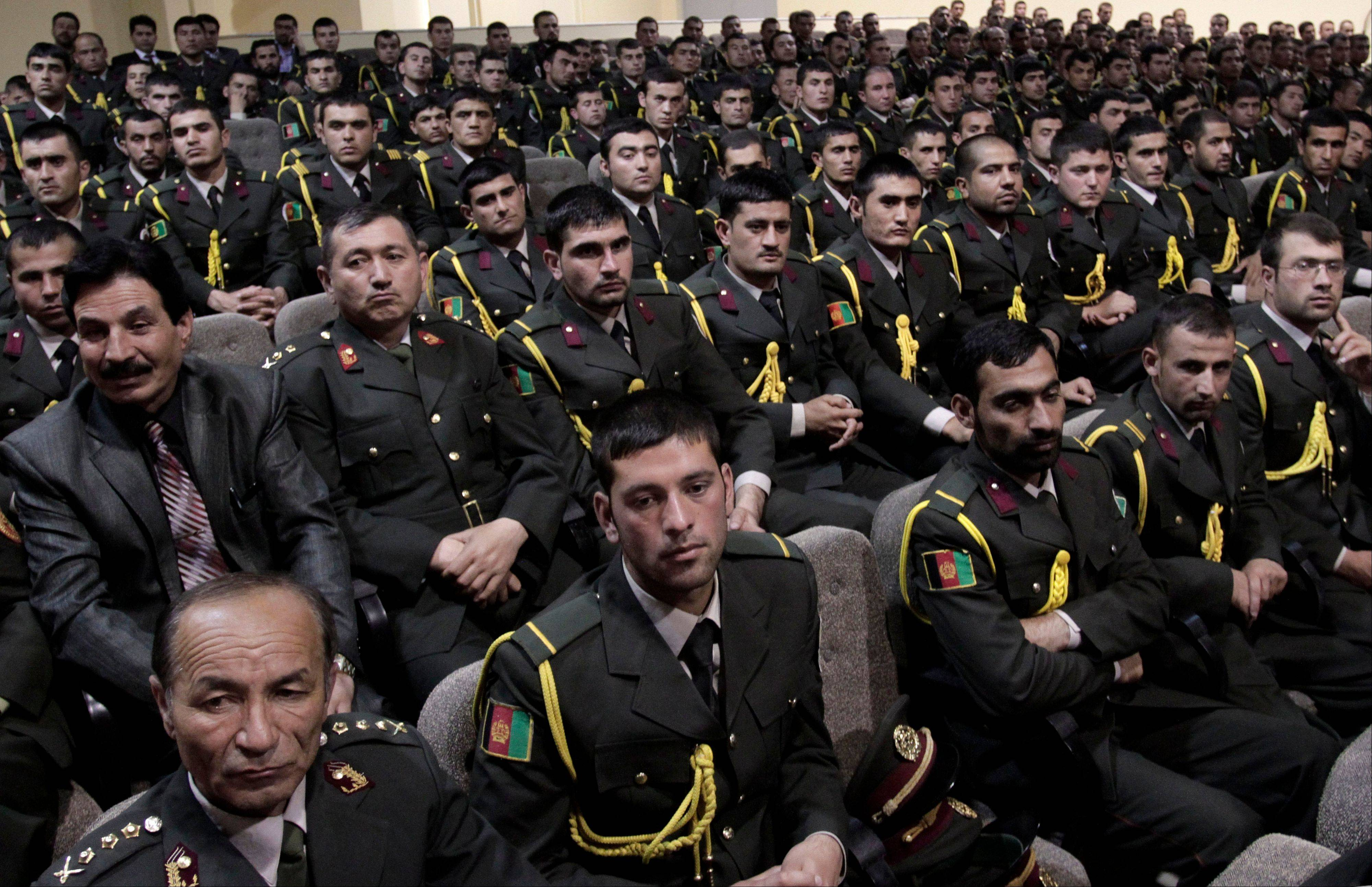 Afghan security officials attend a handover ceremony at a military academy on the outskirts of Kabul, Afghanistan, Tuesday, June 18, 2013. Afghan forces have taken over the lead from the U.S.-led NATO coalition for security nationwide, President Hamid Karzai announced Tuesday in a significant milestone in the 12-year war.