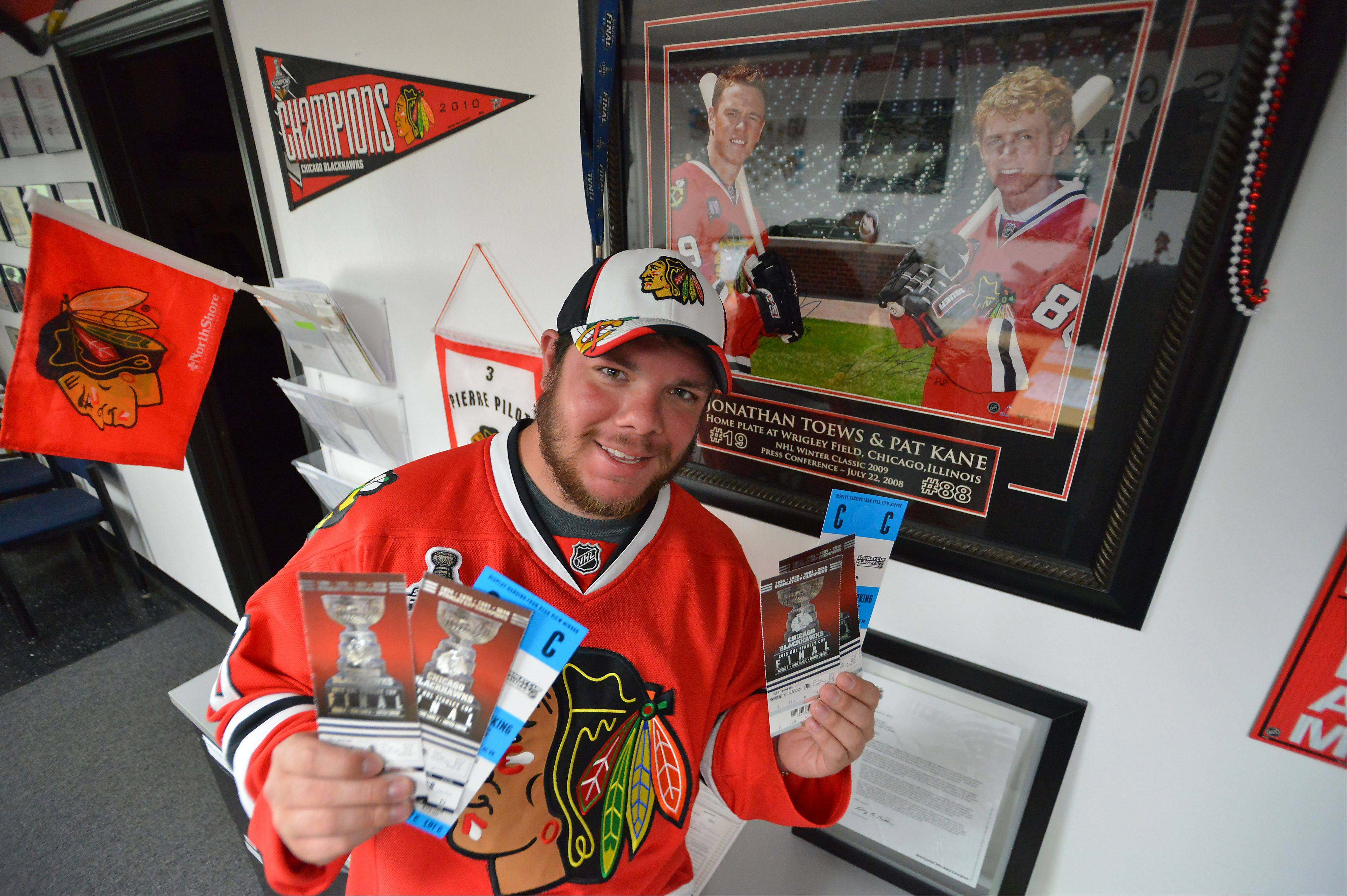 The family-run roofing company Protech of Des Plaines converted their office into a Chicago Blackhawks shrine with Bille Marcum showing off his tickets to Games 5 and 7 of the Stanley Cup Finals. Will there be a Game 7?