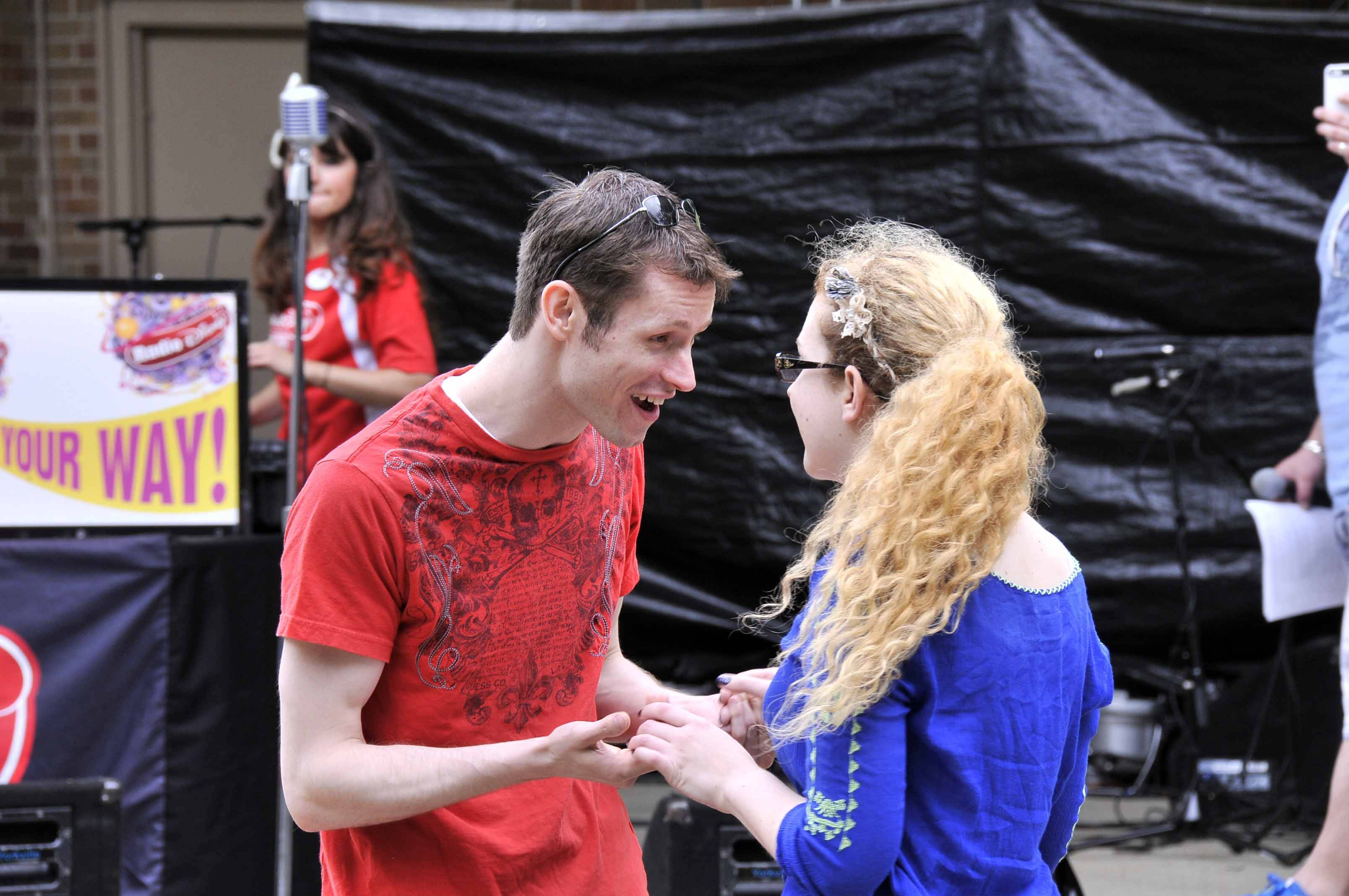 "Garrett Ard as Romeo and Nikki Wilson as Juliet perform during the Taste of Wheaton. Audiences can see the full production of ""Romeo & Juliet"" from June 28-30 and July 5-7 at Wheaton Drama."