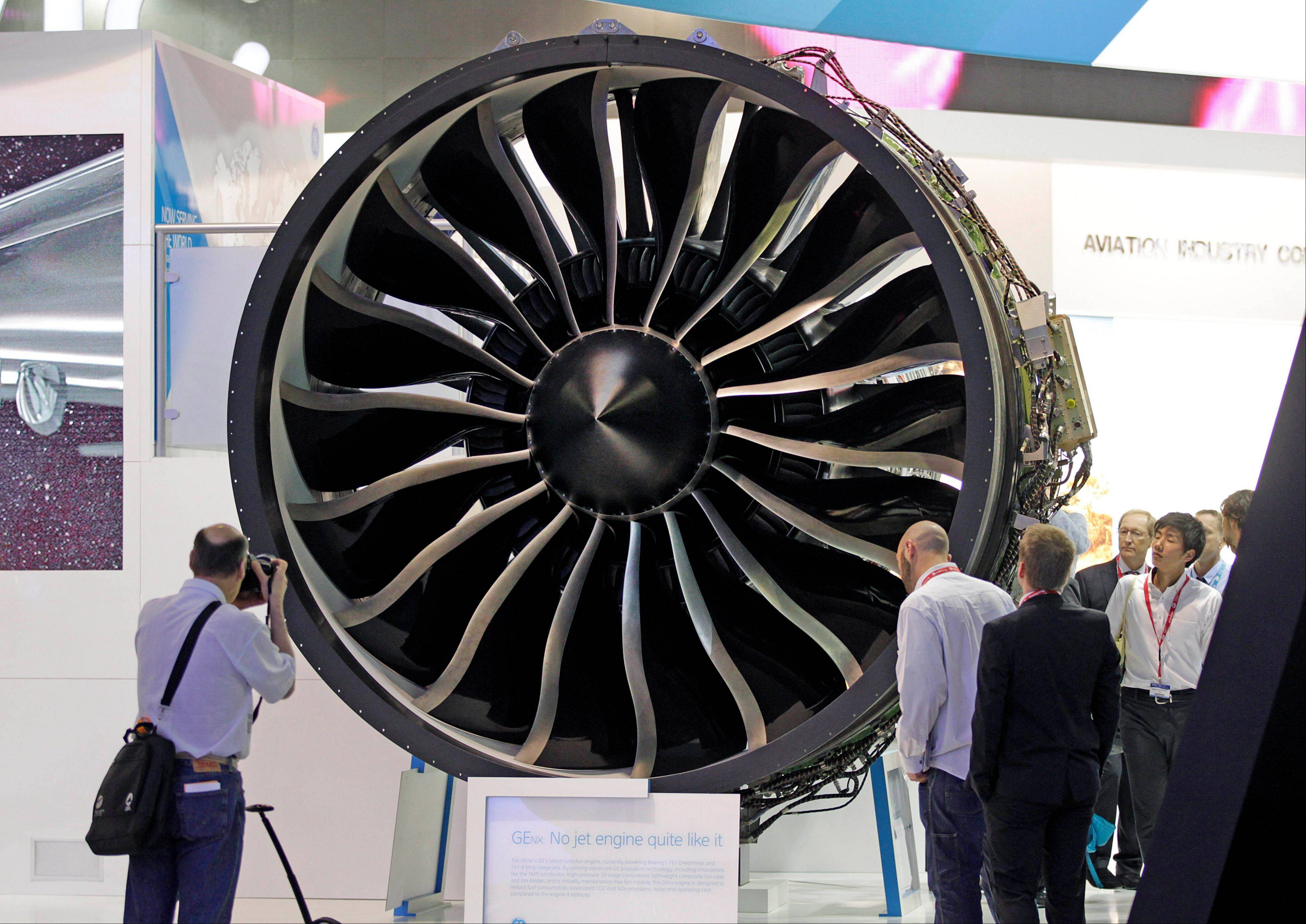 Visitors watch General Electric�s turbo fan �the GEnx engine, powering Boeing 787 Dremliner, during the 50th Paris Air Show at Le Bourget airport, north of Paris, Wednesday June 19, 2013.