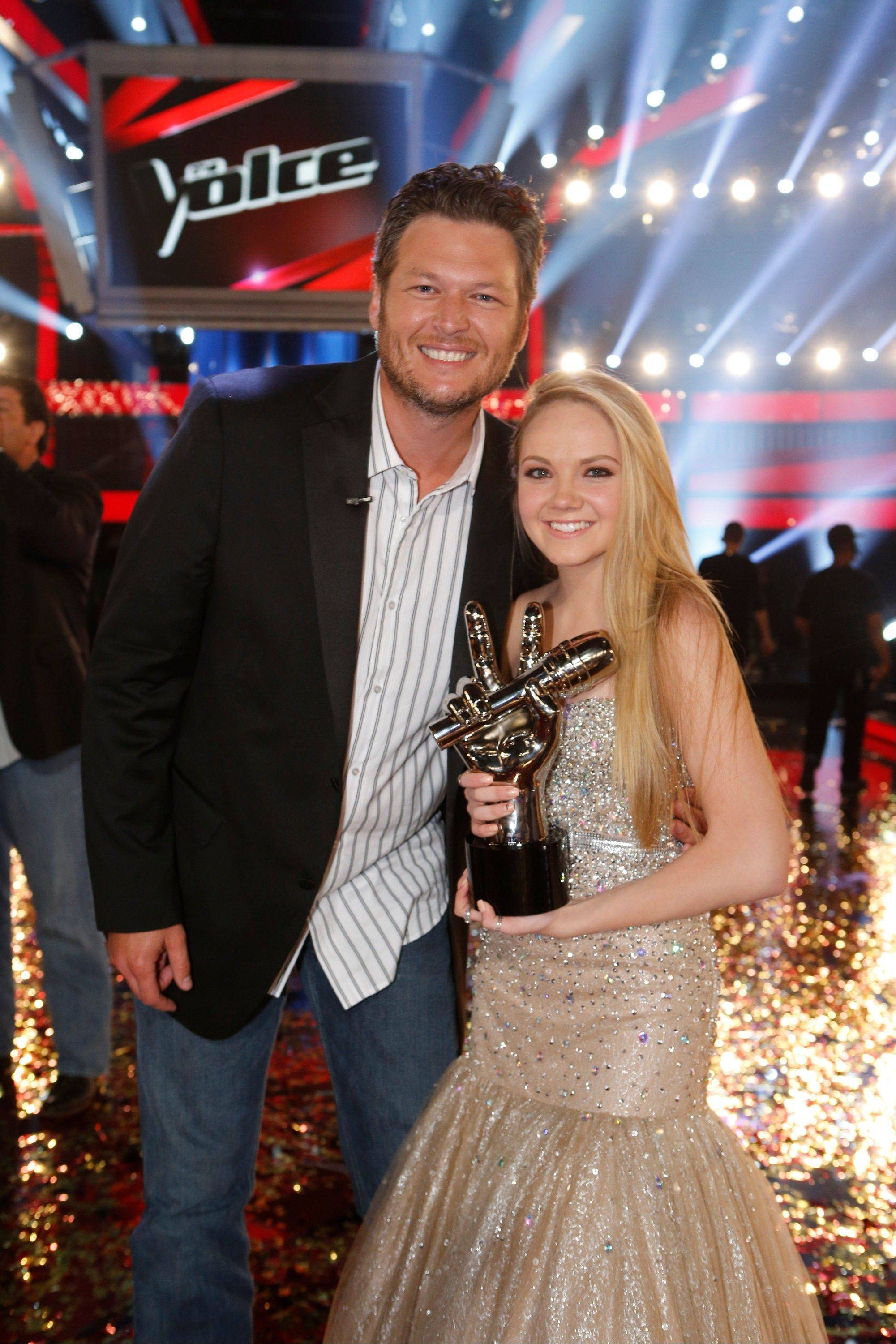 "Blake Shelton, left, and Danielle Bradbery celebrate after she won season-four of ""The Voice"" Tuesday."