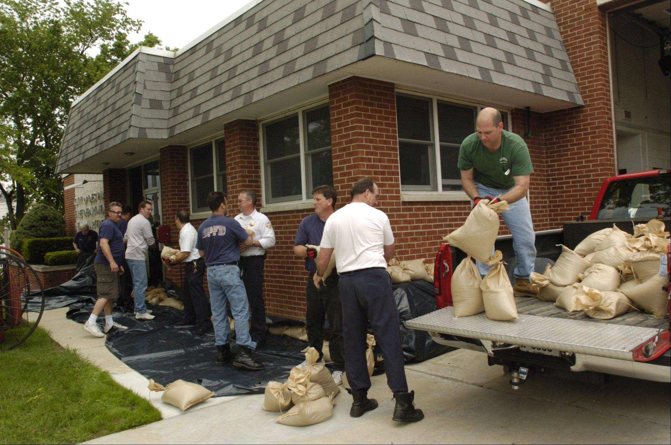 Des Plaines firefighters surround the fire station on River Road with sandbags after the April 17 storm. City officials said this week they won�t be getting any public assistance reimbursement from the Federal Emergency Management Agency.