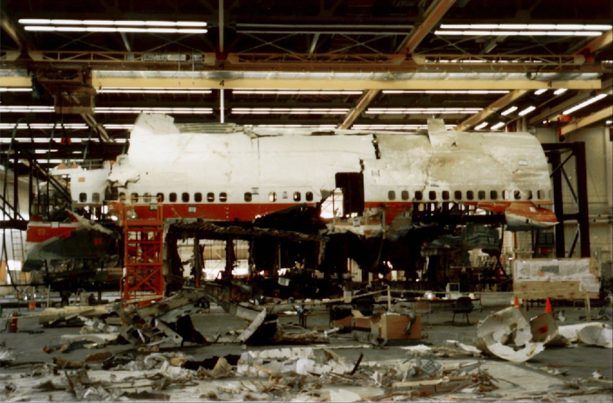 "This 1997 photo released by the National Transportation Safety Board shows reconstruction work on TWA Flight 800, which crashed into the Atlantic Ocean off New York's Long Island. Former NTSB investigators of the crash off are calling on the National Transportation Safety Board to re-examine the case. The retired investigators claim that findings were ""falsified."""