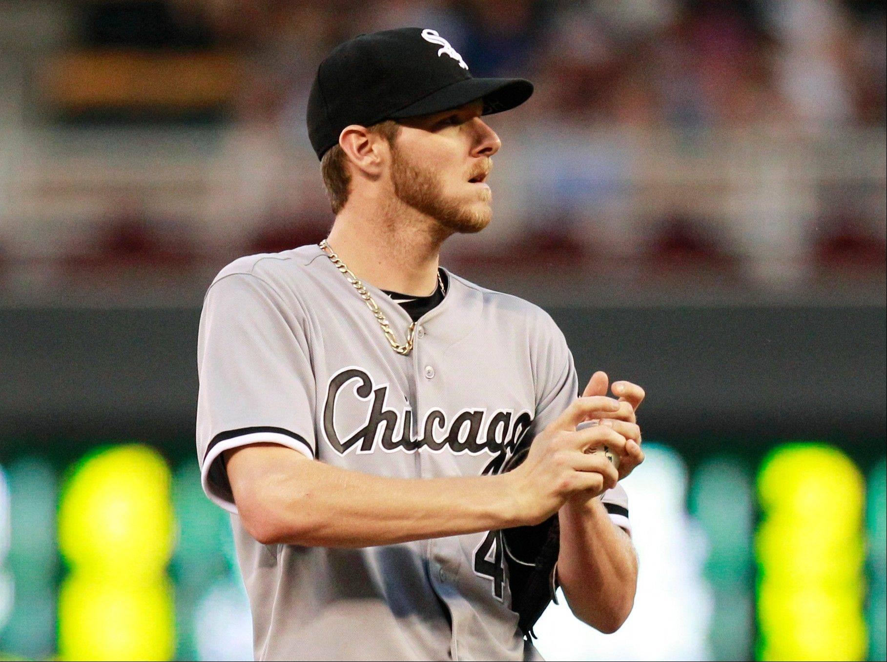White Sox starting pitcher Chris Sale reacts after giving up a single to Minnesota Twins' Ryan Doumit during the fourth inning of a baseball game on Wednesday, June 19, 2013, in Minneapolis.