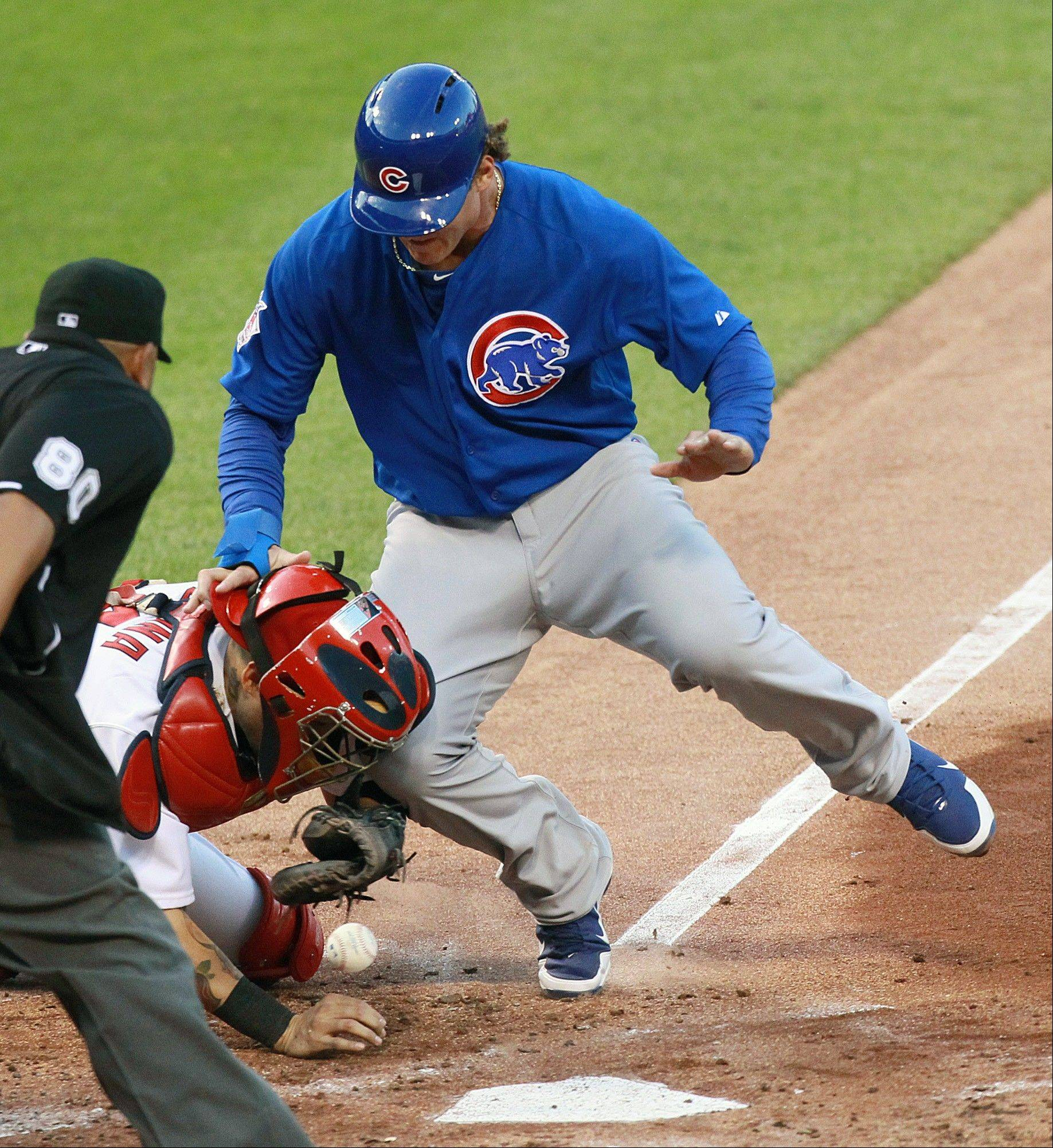 Anthony Rizzo knocks the ball loose from St. Louis Cardinals catcher Yadier Molina as he scores in the second inning of a baseball game against the Chicago Cubs on Wednesday, June 19, 2013, at Busch Stadium in St. Louis.