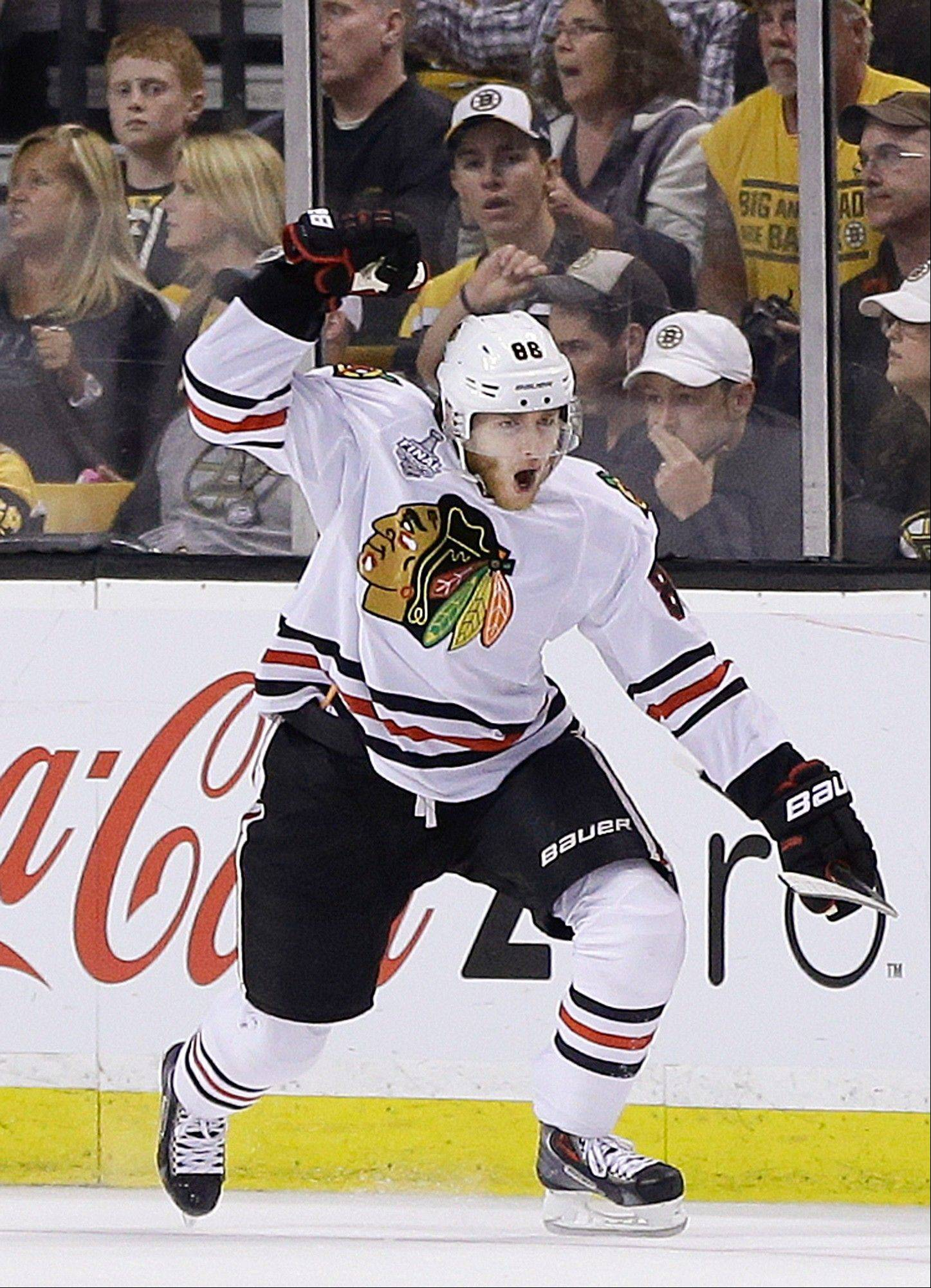 Blackhawks right wing Patrick Kane (88) celebrates his goal against the Bruins during Wednesday night's game in Boston.