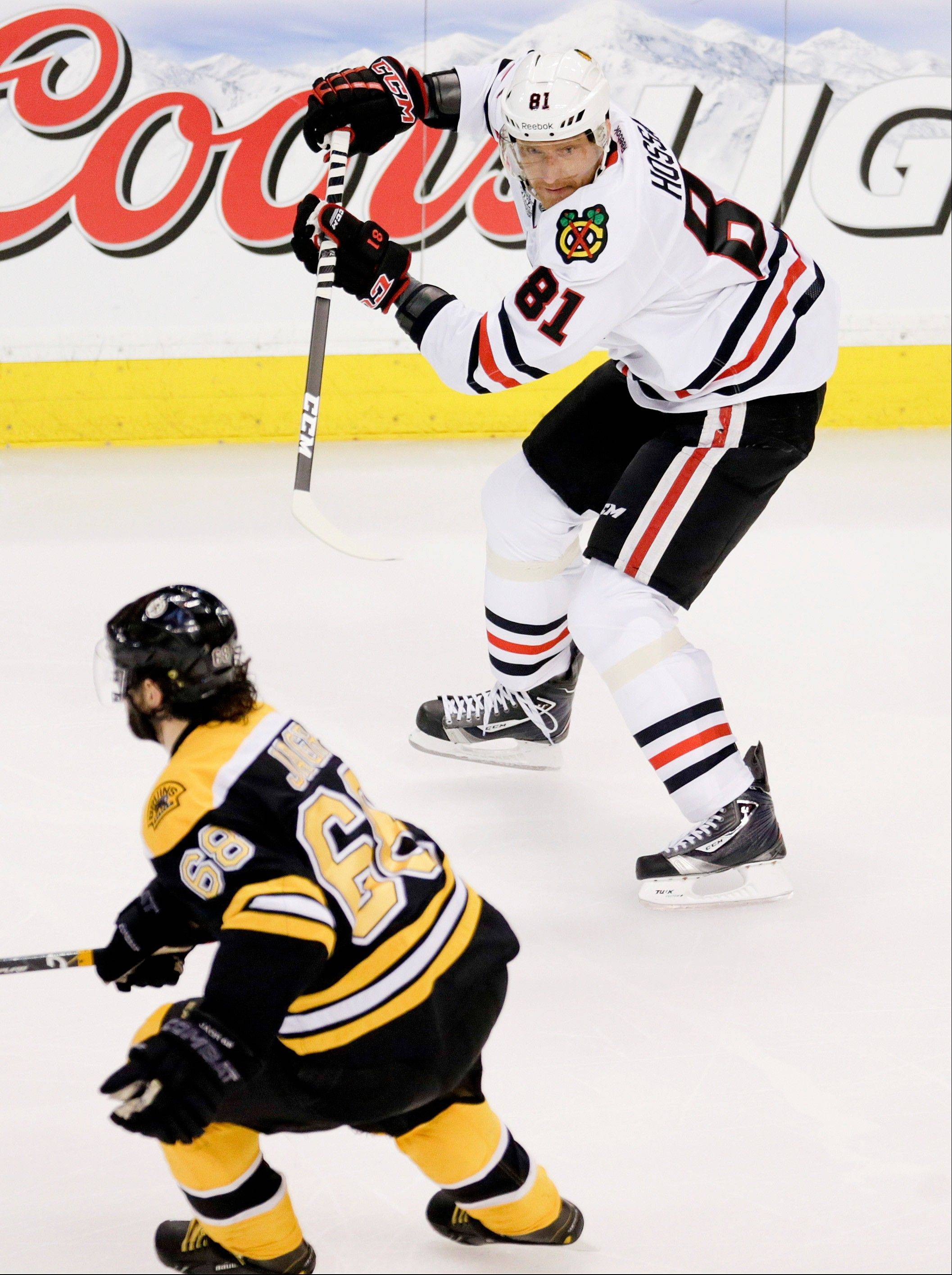 Blackhawks winger Marian Hossa looks for a pass Wednesday as Boston Bruins winger Jaromir Jagr defends in the first period of Game 4 of the Stanley Cup Final.