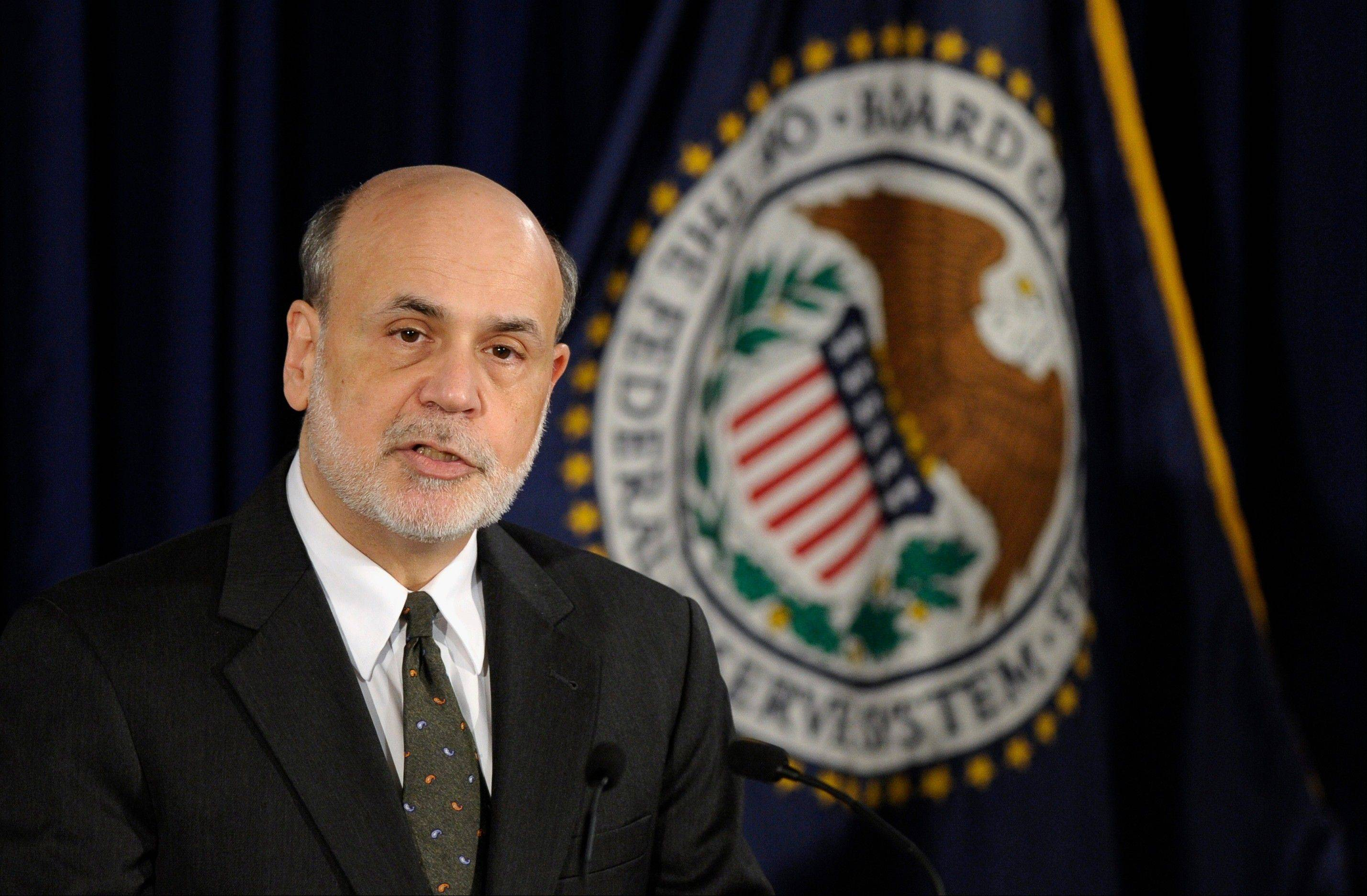 Federal Reserve Chairman Ben Bernanke speaks during a news conference Wednesday, after the Fed said it will maintain the pace of its bond-buying program to keep long-term interest rates at record lows.