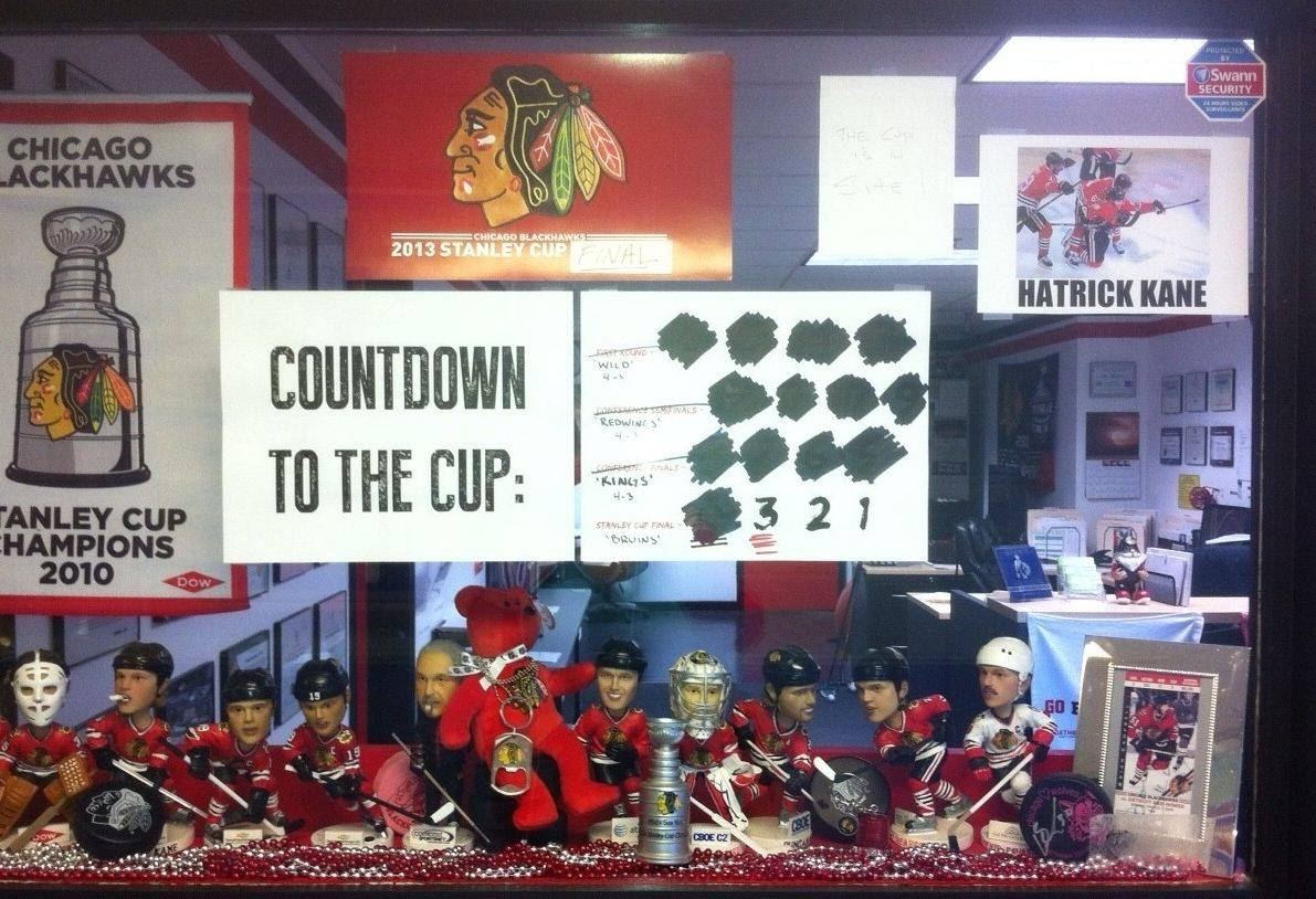 The window in front of Pro-Tech Roofing Co. in Des Plaines is filled with Blackhawks bobbleheads and memorabilia. Everyone in the family-run business is an avid Blackhawks fan.