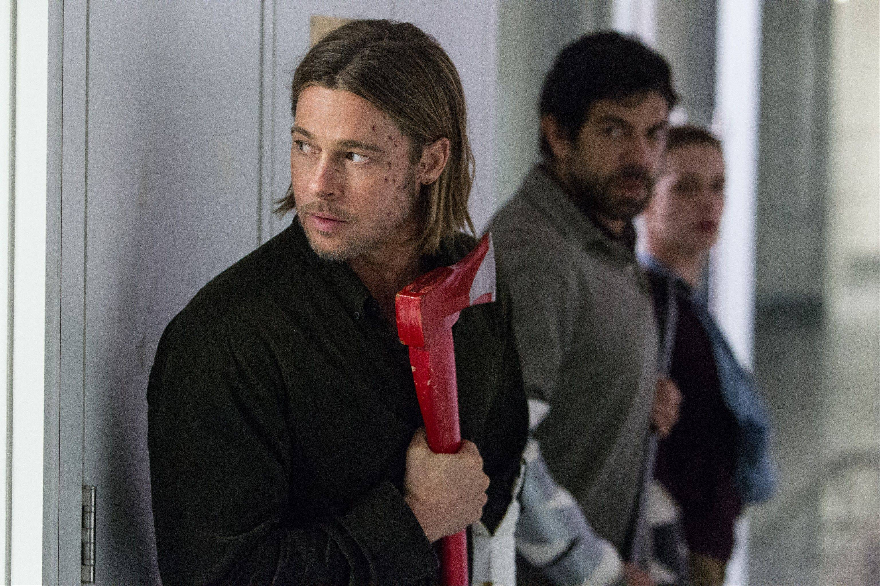 "U.N. investigator Gerry Lane (producer Brad Pitt) has an ax to grind with zombies at a research facility in the action thriller ""World War Z."""