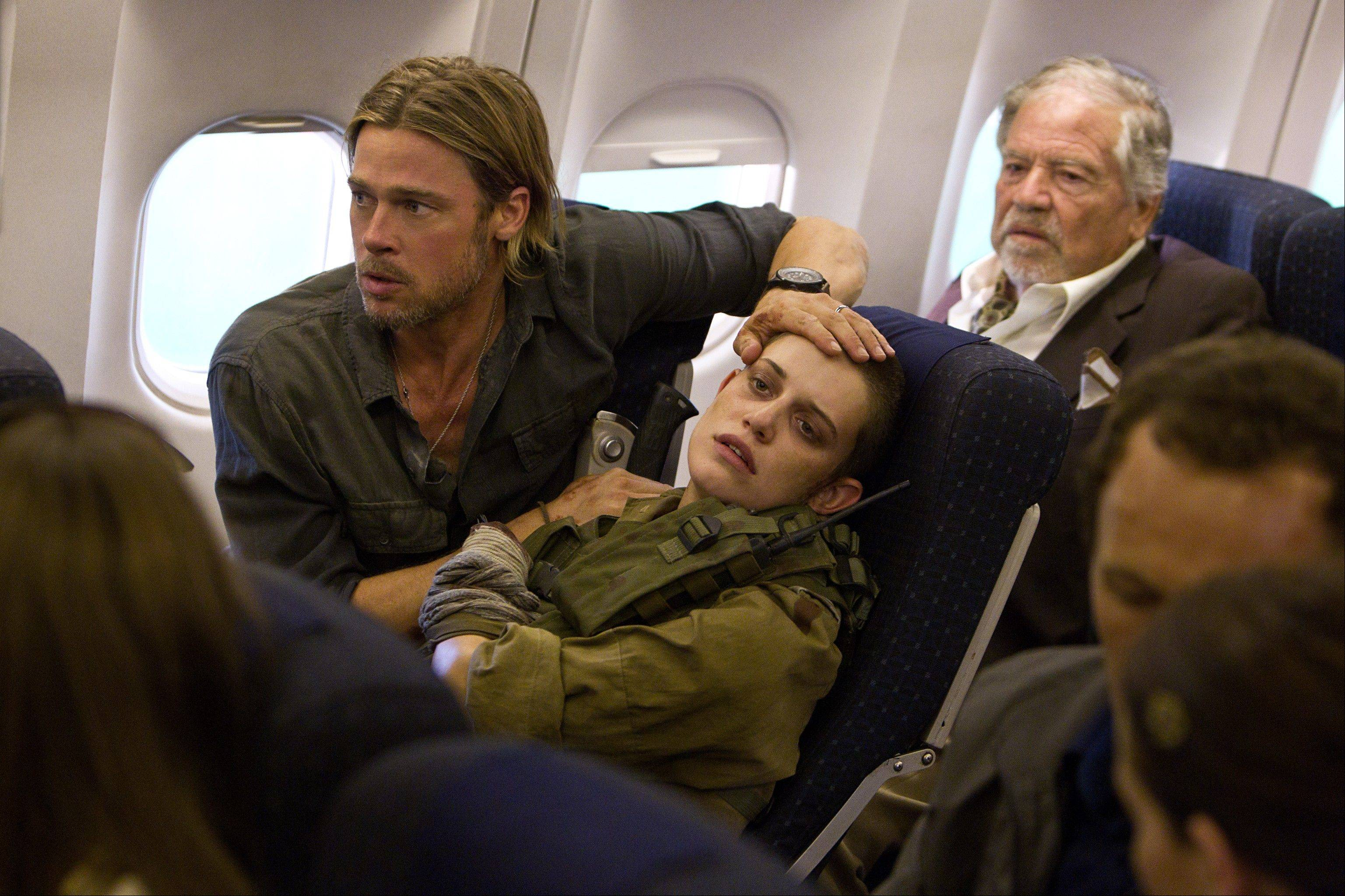 "U.N. investigator Gerry Lane (producer Brad Pitt) comforts a wounded Israeli soldier (Daniella Kertész) on an ill-fated plane trip in the action thriller ""World War Z."""