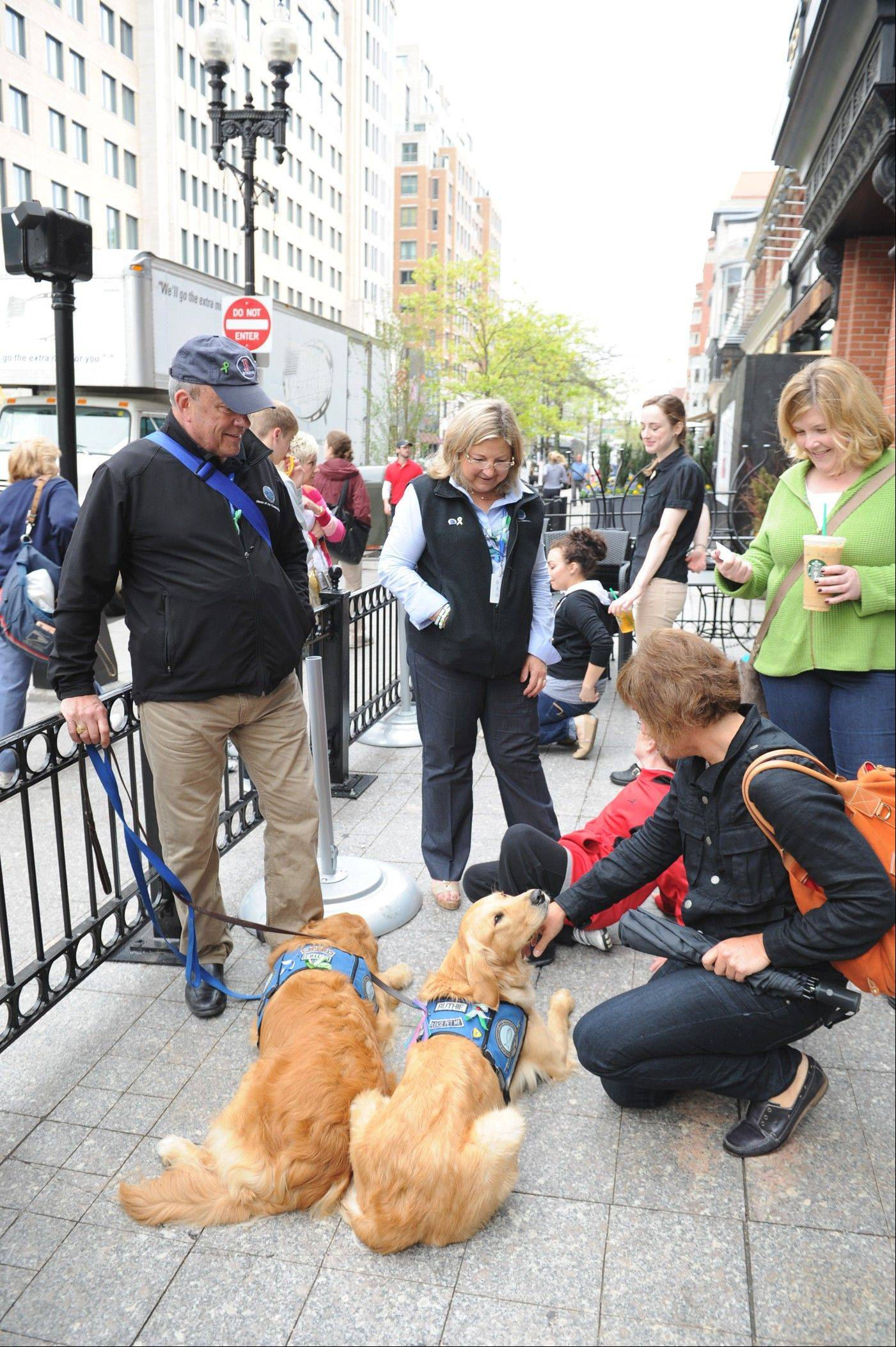 Rich Martin with K-9 Luther, Dona Martin with K-9 Ruthie visit business that were closed due to the Boston bombing.