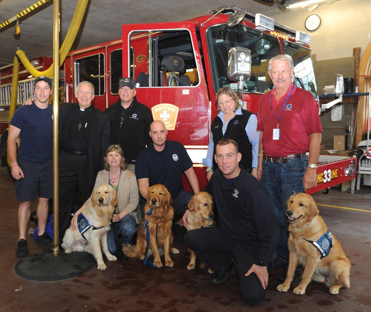 Lutheran pastor Ingo Dutzmann and members of the Addison-based K-9 Dog Ministry visit Boston Engine 33 firefighters and first responders to the recent marathon bombings with comfort dogs Moses, Luther, Ruthie and Susie.