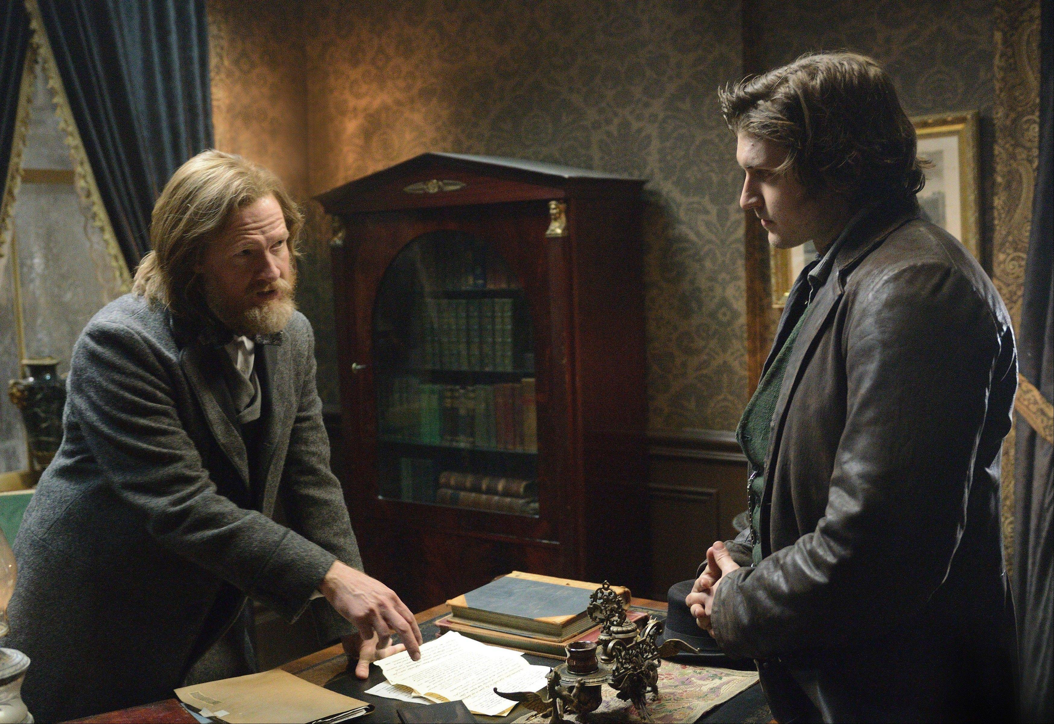 "General Brendan Donovan (Donal Logue) talks with Detective Kevin Corcoran (Tom Weston-Jones) in BBC America's ""Copper."""