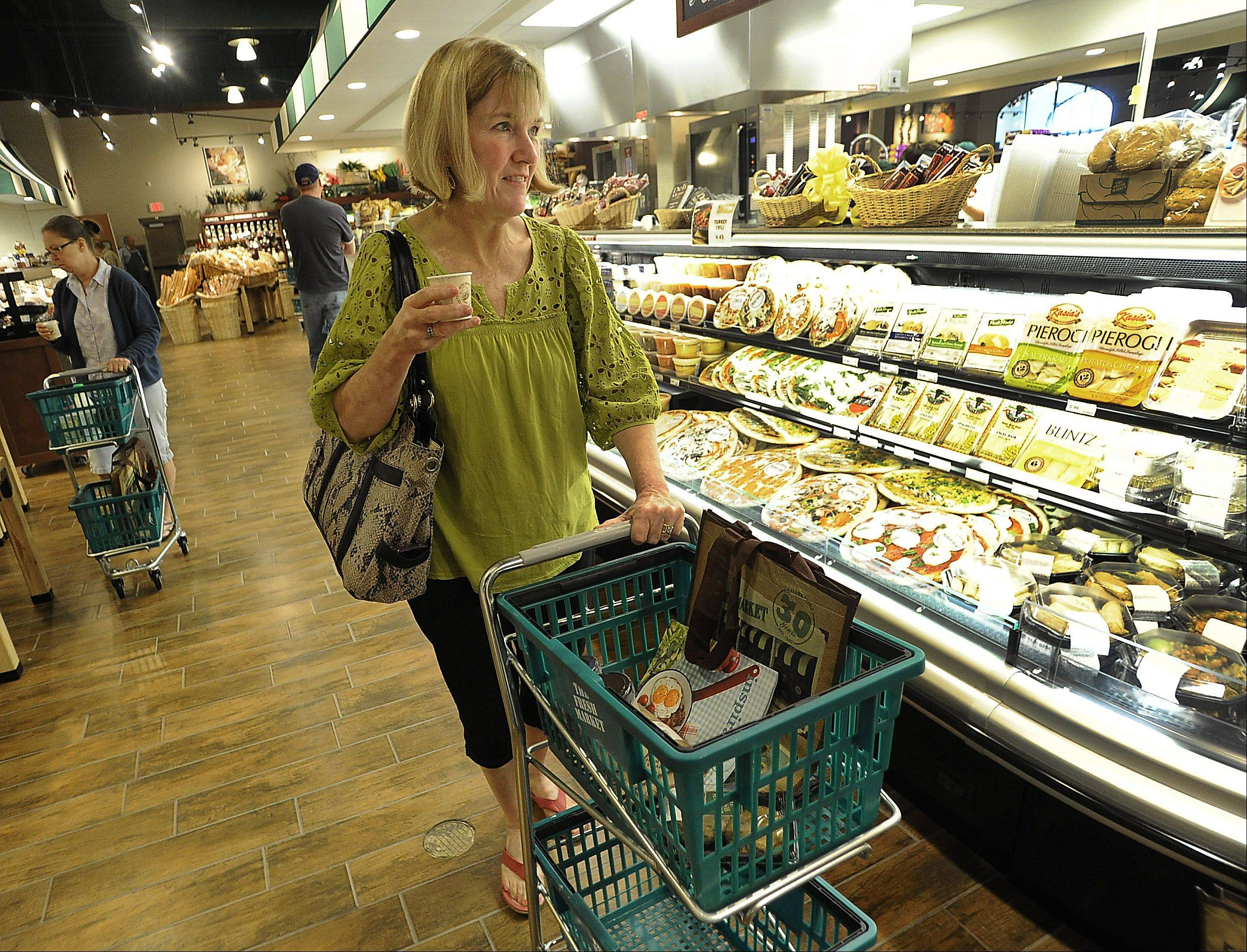 Shopper Kim Young of Vernon Hills enjoys the grand opening of The Fresh Market in Lincolnshire on Wednesday. The supermarket is the first in Lincolnshire's 56-year history.