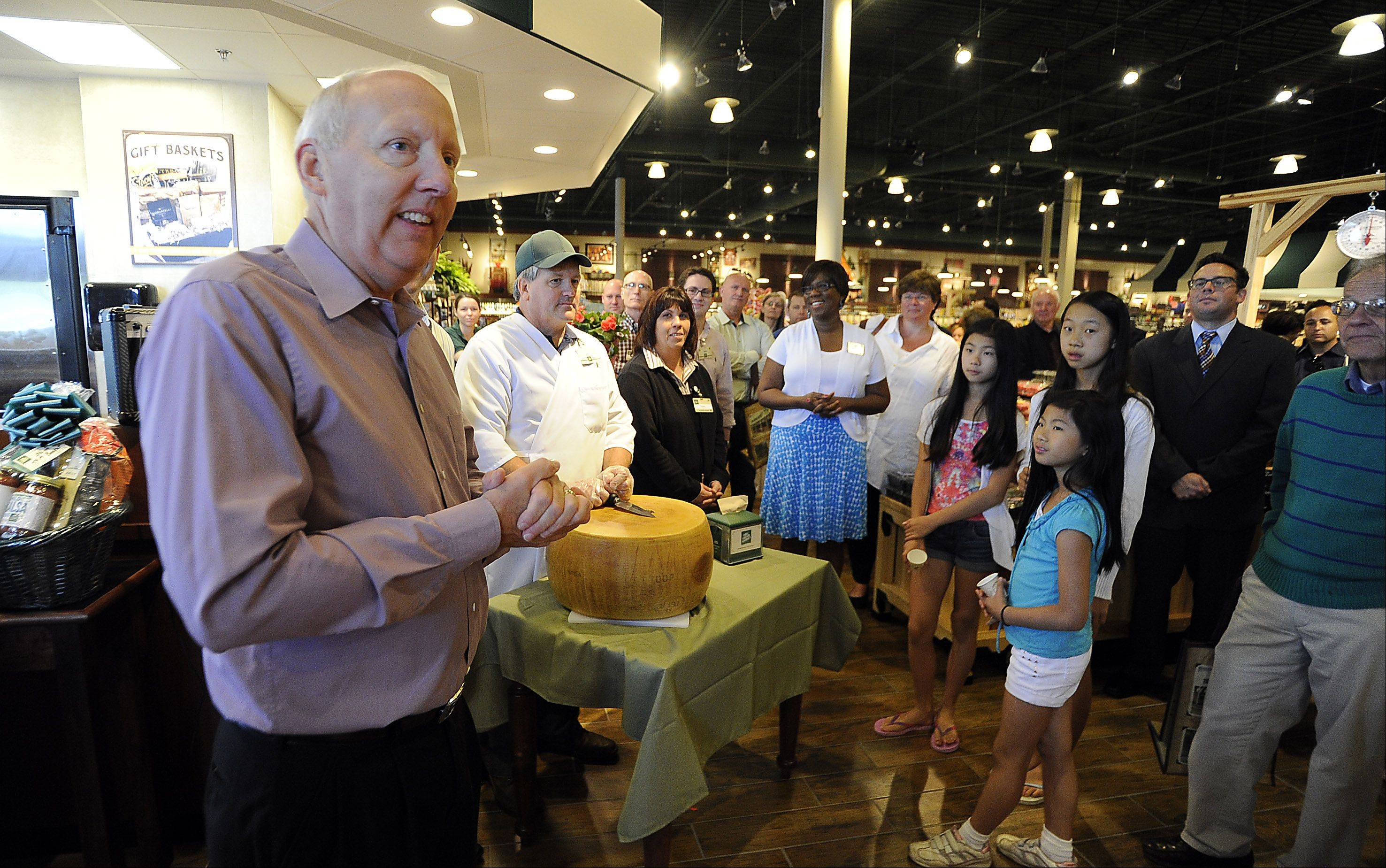 "Lincolnshire Mayor Brett Blomberg speaks Wednesday at the grand opening of The Fresh Market store just before the ""cracking the Parmesan"" event symbolizing the official opening."