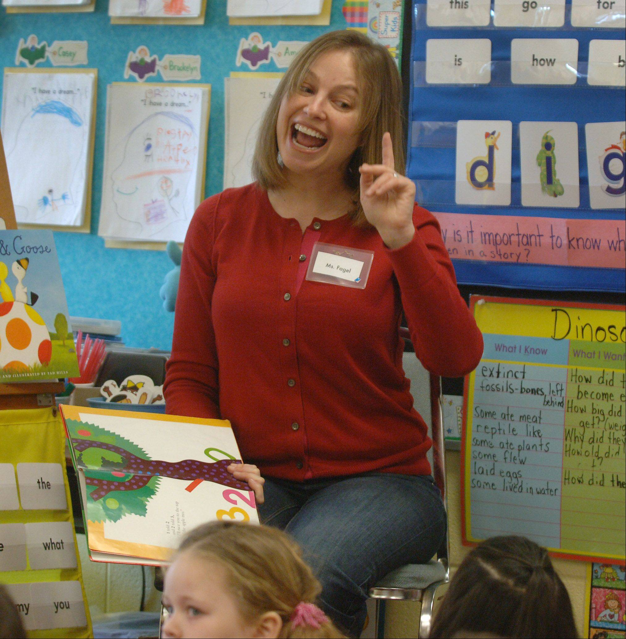 Mundelein High School principal Lauren Fagel, here reading to Fairhaven School kindergartners earlier this year, has announced her resignation to pursue undisclosed career opportunities elsewhere.