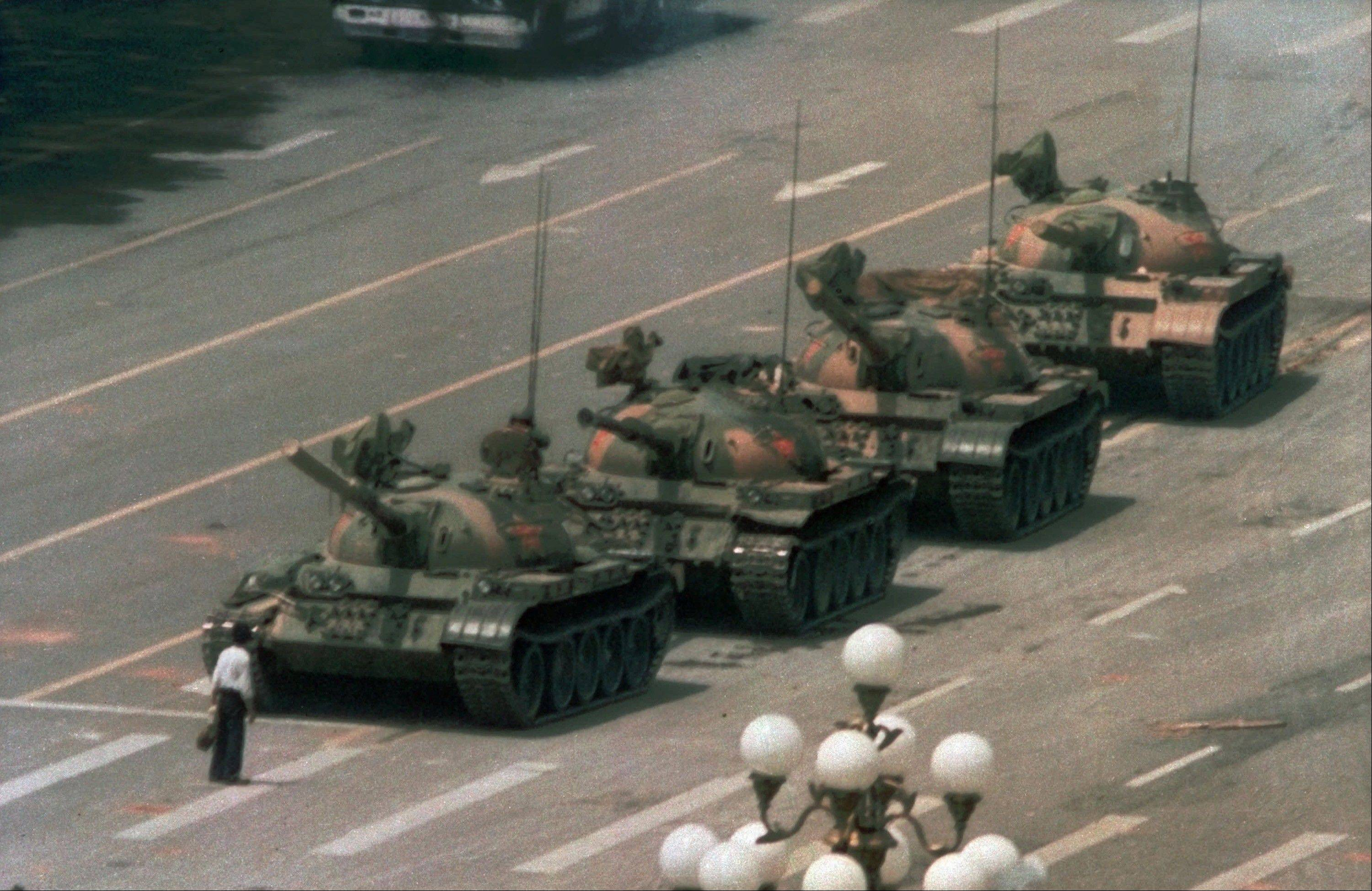 A Chinese man stands alone to block a line of tanks heading east on Beijing's Cangan Blvd. in Tiananmen Square in 1989.