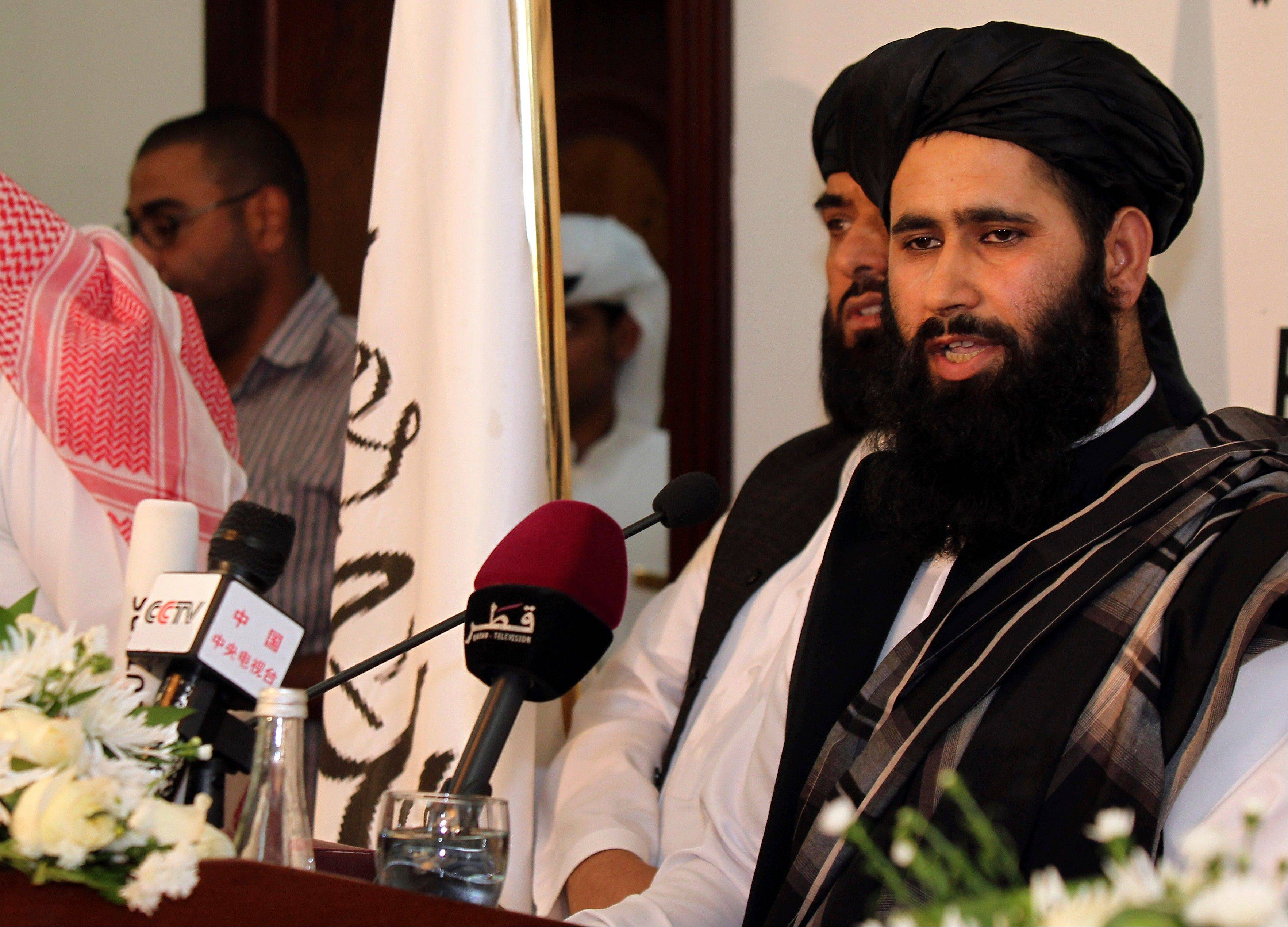 Muhammad Naeem a representative of the Taliban speaks during a press conference at the official opening of their office in Doha, Qatar, Tuesday, June 18, 2013. The Taliban and the U.S. announced Tuesday that they will hold talks on finding a political solution to ending nearly 12 years of war in Afghanistan, but on Wednesday Afghanistan's president said Wednesday he will not pursue peace talks with the Taliban unless the United States steps out of the negotiations.