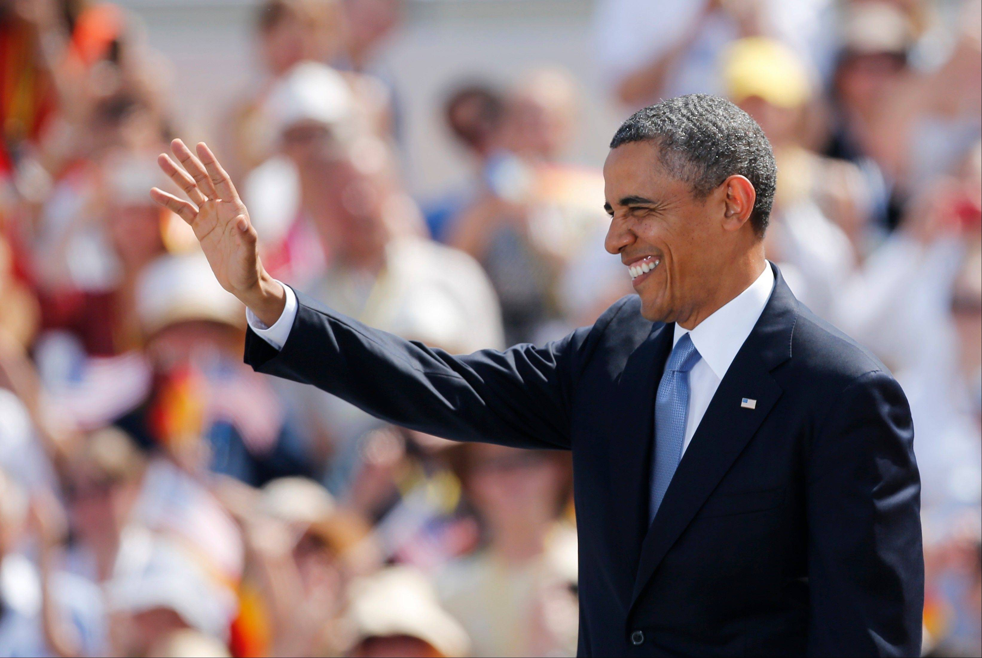 President Barack Obama waves as he arrives for a speech at Brandenburg Gate where he is to deliver a speech in Berlin Wednesday, June 19, 2013. Obama is on a two-day official visit to the German capital.