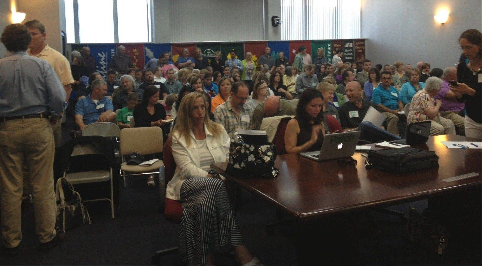 The first formal hearing for a permanent supportive housing facility proposed near downtown Palatine drew an overflow and passionate crowd at the plan commission meeting Tuesday.