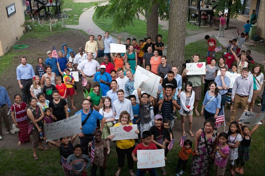 Residents of the Parkside Apartments in Glen Ellyn gathered Monday night before walking together to the village's Civic Center to protest plans that would create a tax increment financing district and possibly displace them from their homes.