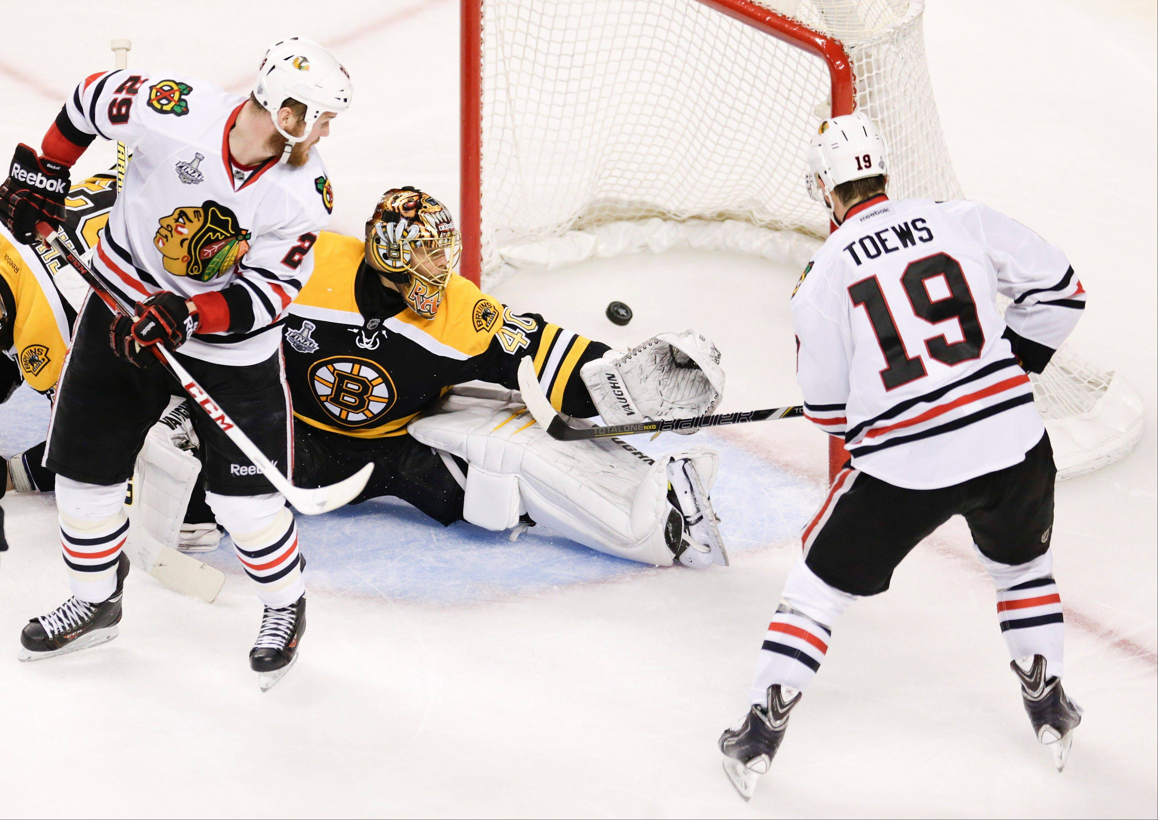 Chicago Blackhawks center Jonathan Toews (19) scores a goal past Boston Bruins goalie Tuukka Rask (40), of Finland, during the second period in Game 4 of the NHL hockey Stanley Cup Finals.