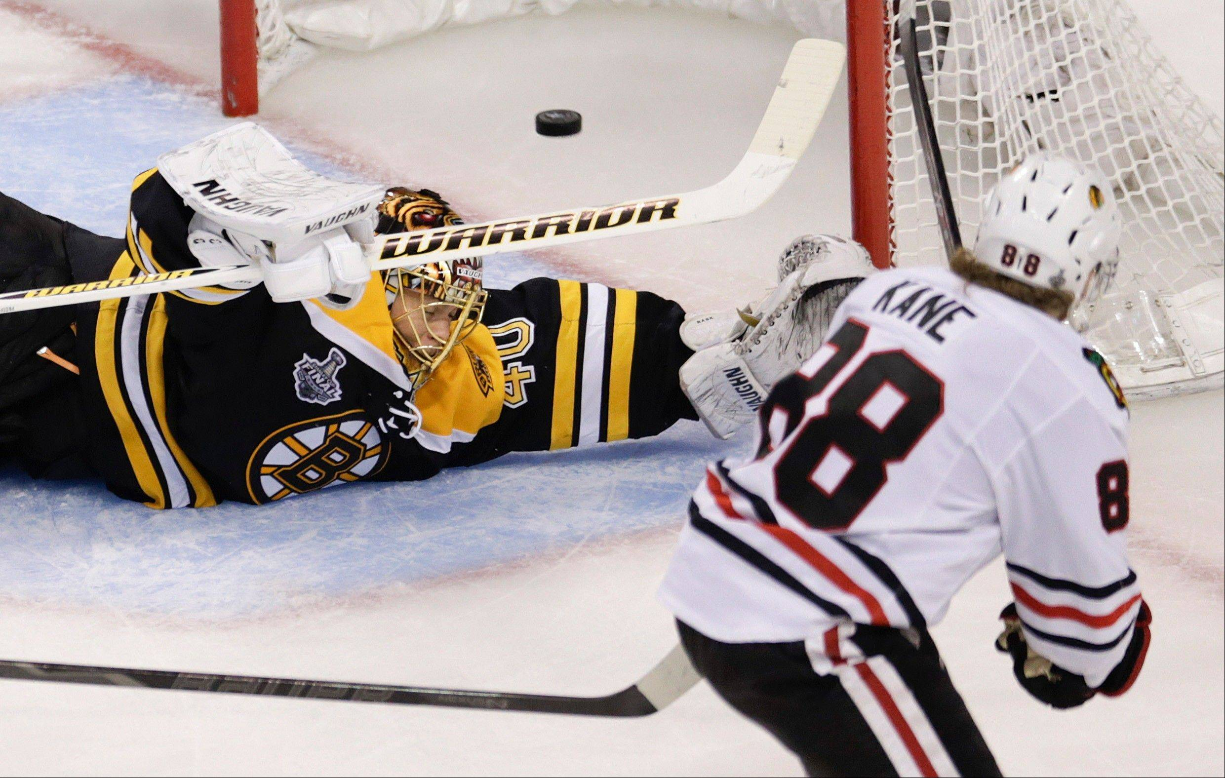 Chicago Blackhawks right wing Patrick Kane (88) scores past Boston Bruins goalie Tuukka Rask (40), of Finland, during the second period in Game 4 of the NHL hockey Stanley Cup Finals.
