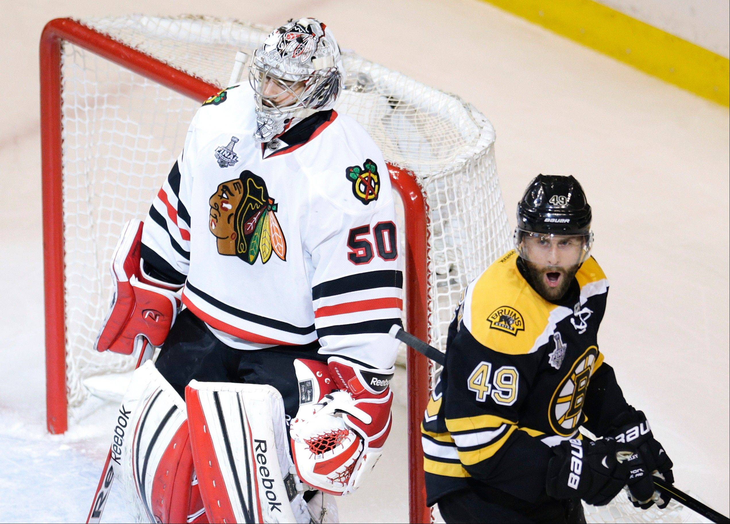 Boston Bruins center Rich Peverley (49) celebrates his goal in front of Chicago Blackhawks goalie Corey Crawford (50) during the first period in Game 4 of the NHL hockey Stanley Cup Finals.
