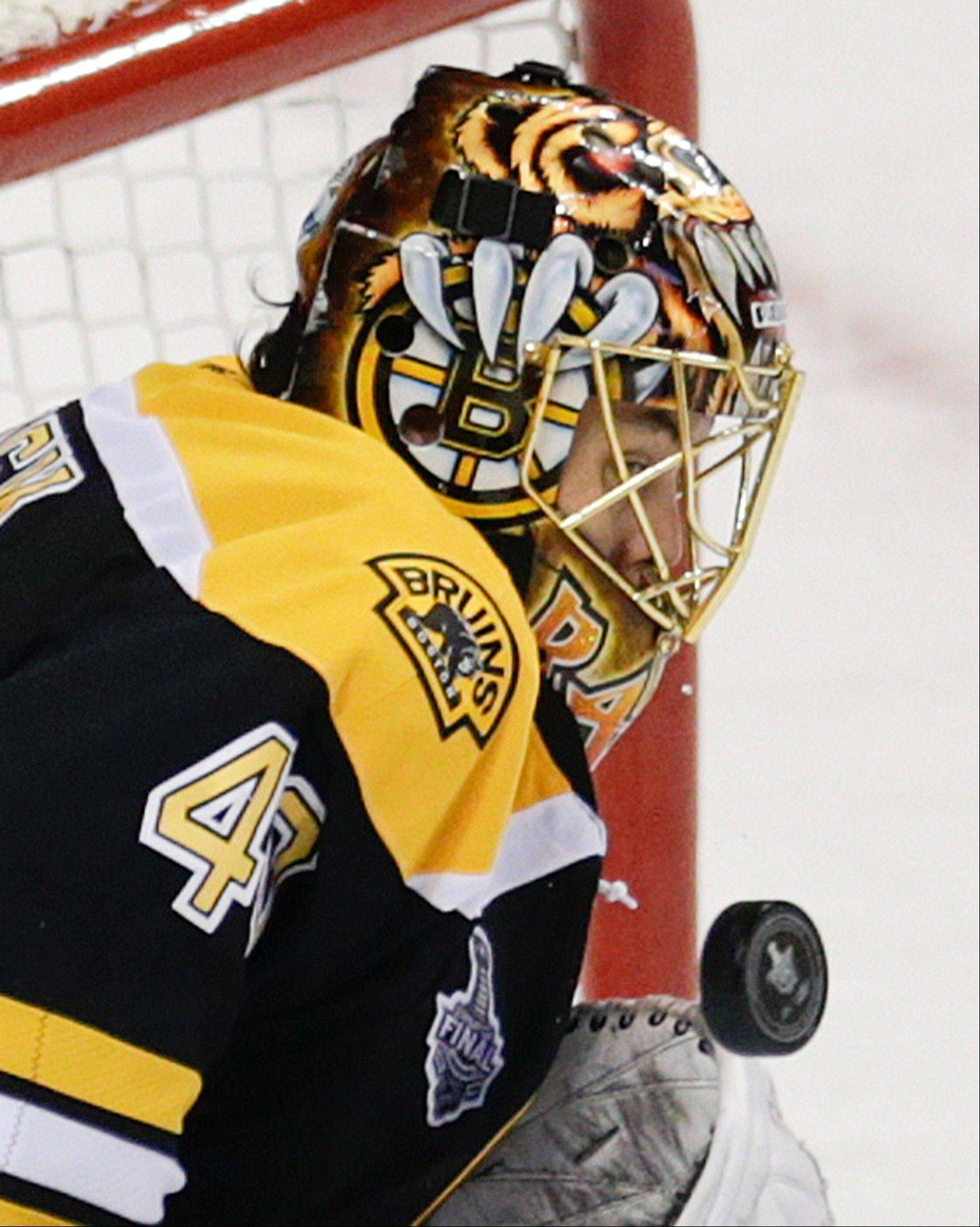 Boston Bruins goalie Tuukka Rask (40), of Finland, turns aside the puck against the Chicago Blackhawks during the first period in Game 4 of the NHL hockey Stanley Cup Finals.