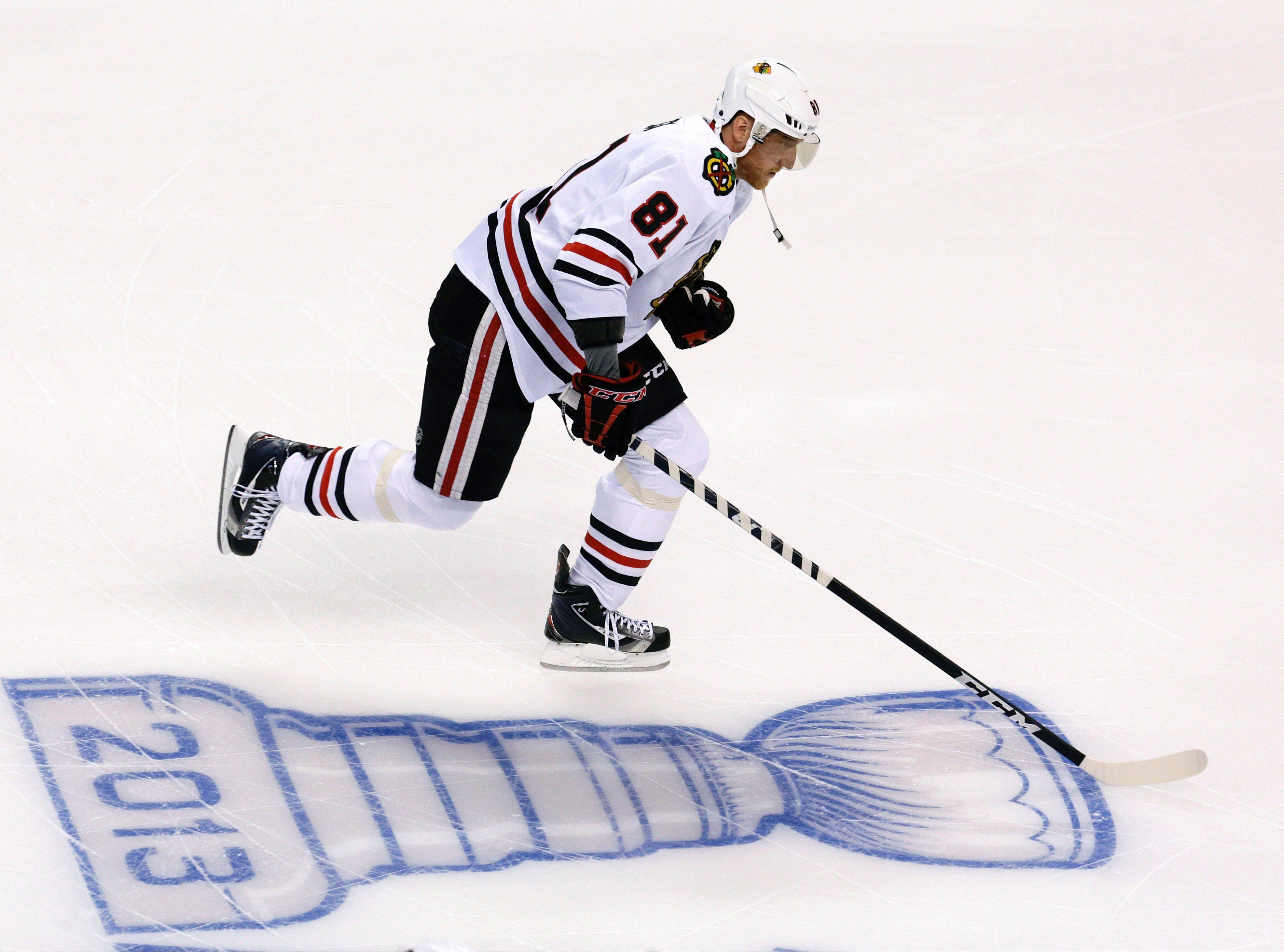 Chicago Blackhawks right wing Marian Hossa (81), of Slovakia, skates during warm-ups before Game 4 of the NHL hockey Stanley Cup Finals between the Boston Bruins and the Blackhawks.