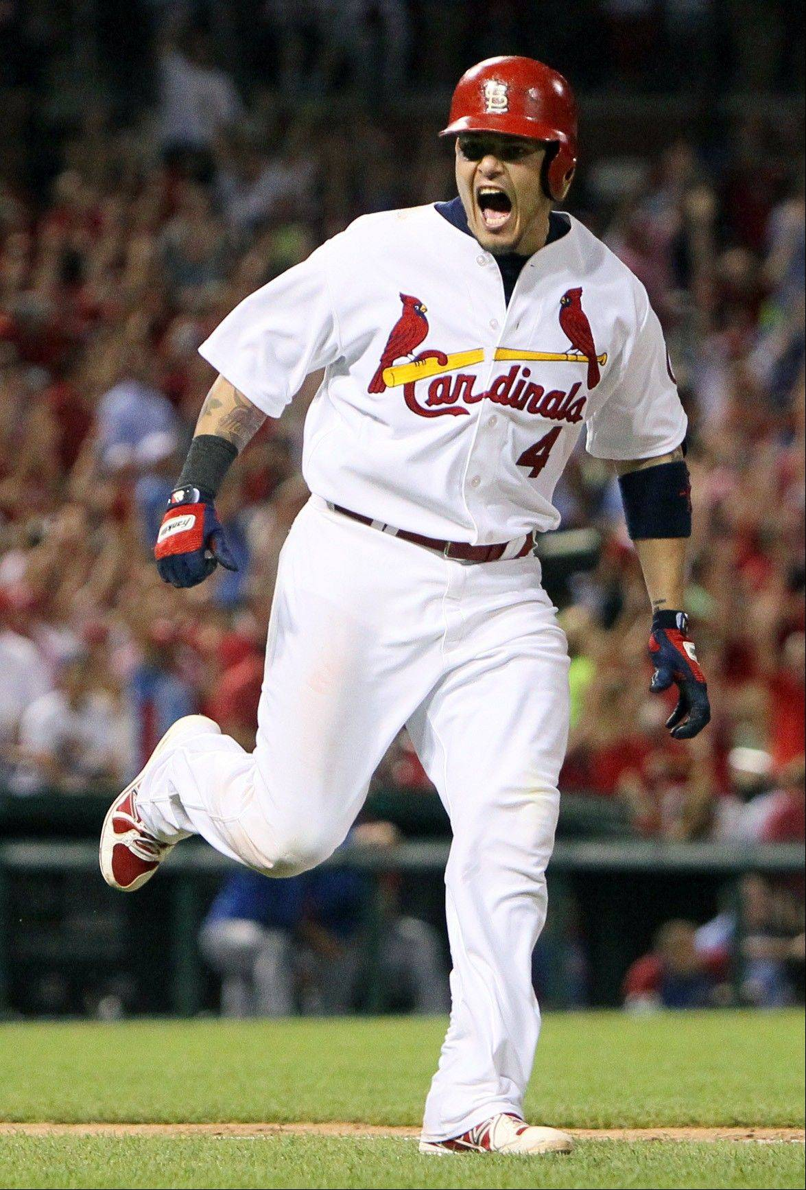 St. Louis Cardinals' Yadier Molina reacts after hitting the go-ahead two-run home run in the sixth inning of a baseball game against the Chicago Cubs on Wednesday, June 19, 2013, at Busch Stadium in St. Louis.