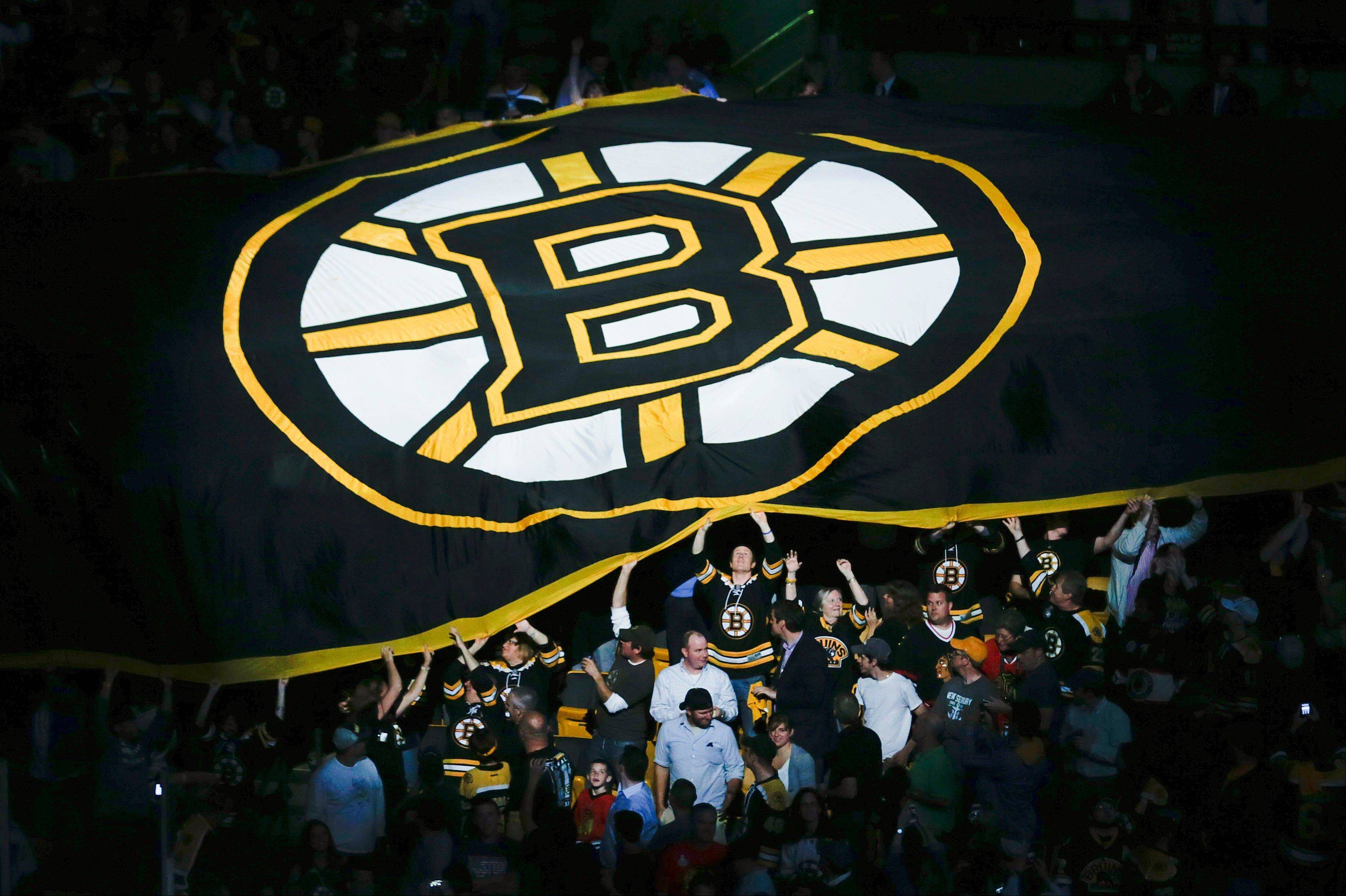 Fans pass a Boston Bruins banner through the stands before Wednesday's Game 4 of the Stanley Cup Final at TD Garden.