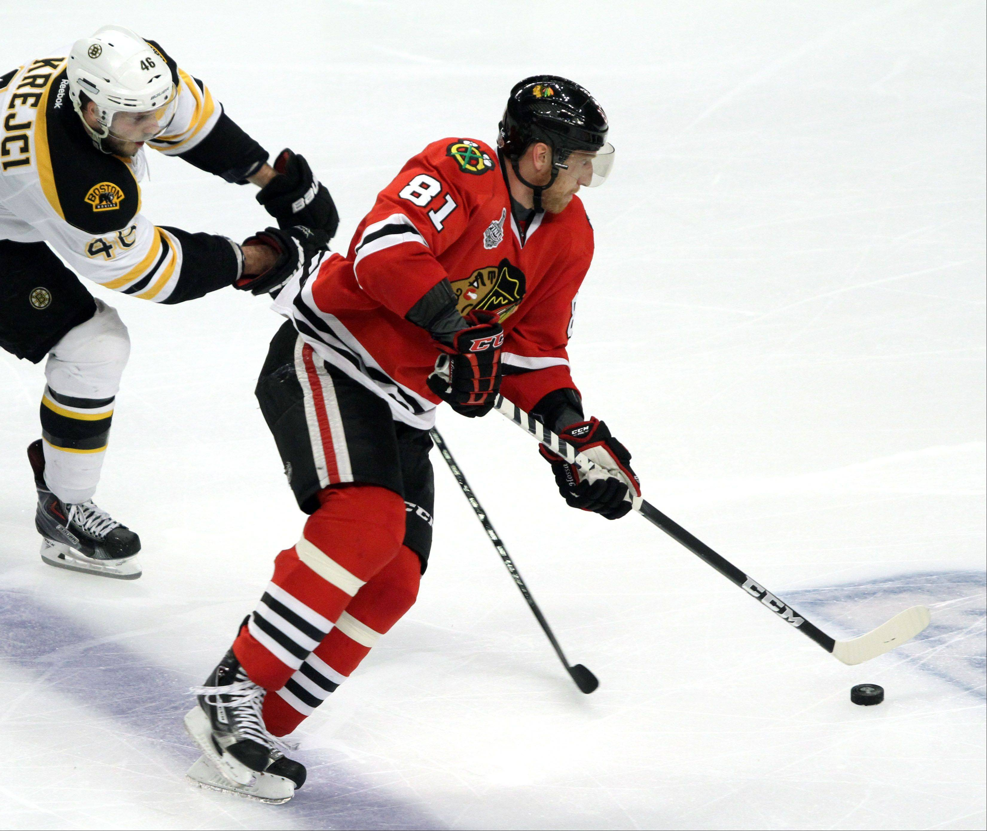 Blackhawks right wing Marian Hossa, here driving past Boston Bruins center David Krejci during Game 2 of the Stanley Cup Finals last Saturday, missed Game 3 on Monday due to an injury. He is expected to play in Game 4.