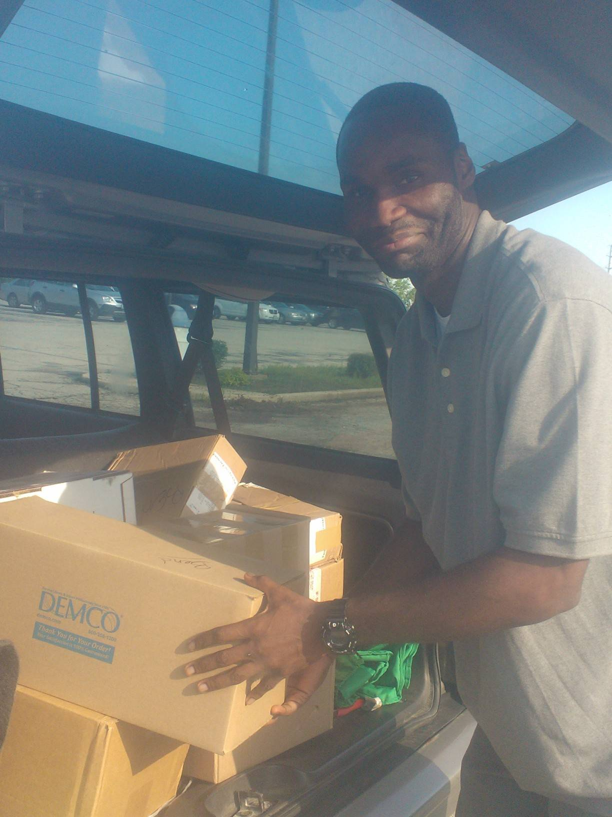 Eric Crockwell of IYC-Warrenville helps unload a donation from the West Chicago Public Library.
