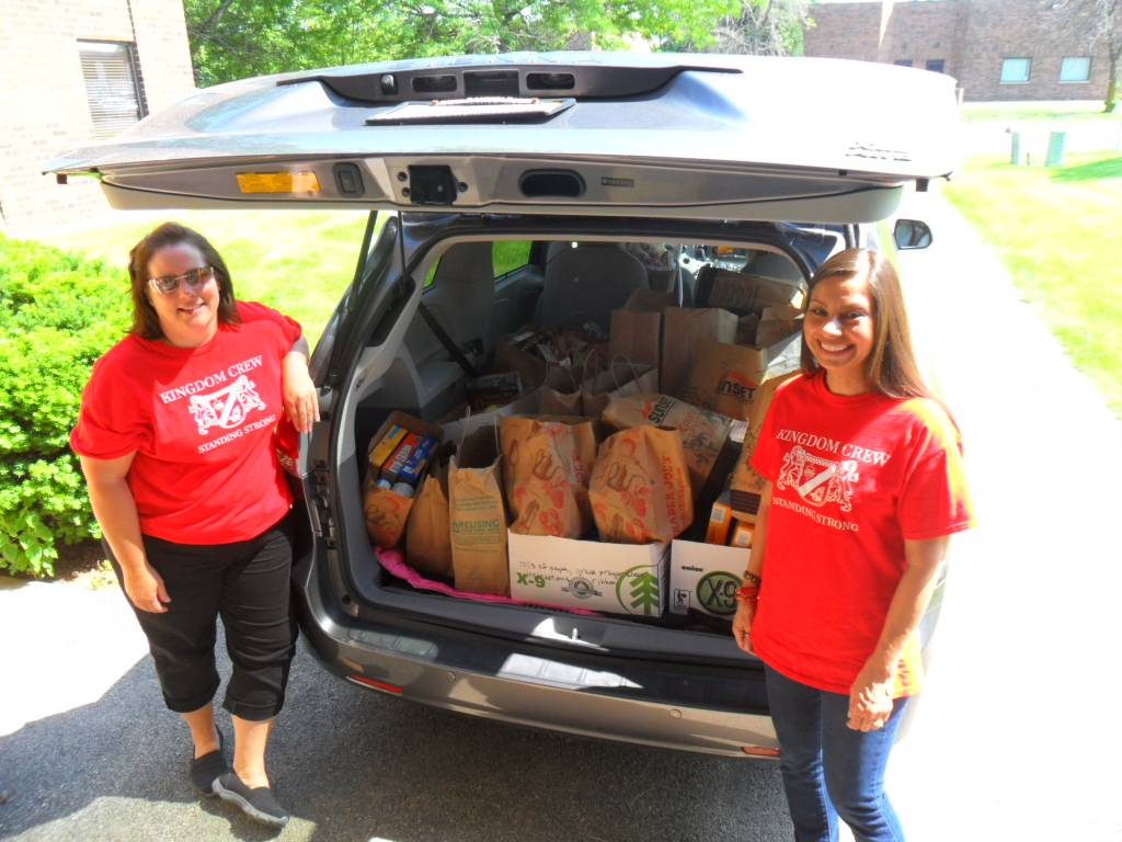 Geri Ferrari and Karen Doman dropping off the food collected by the VBS.