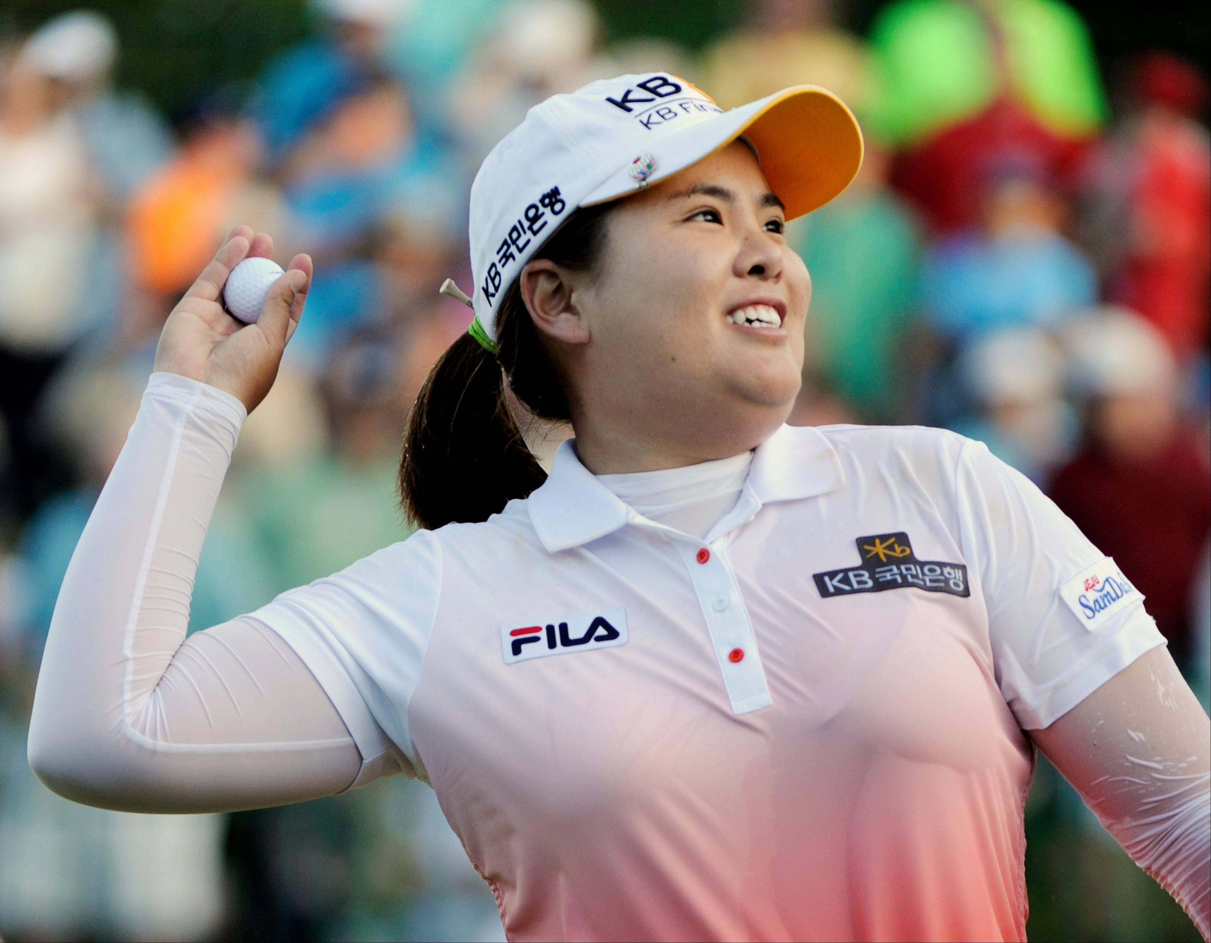 Inbee Park throws the ball into the stands after winning a playoff for the LPGA Championship on June 9.