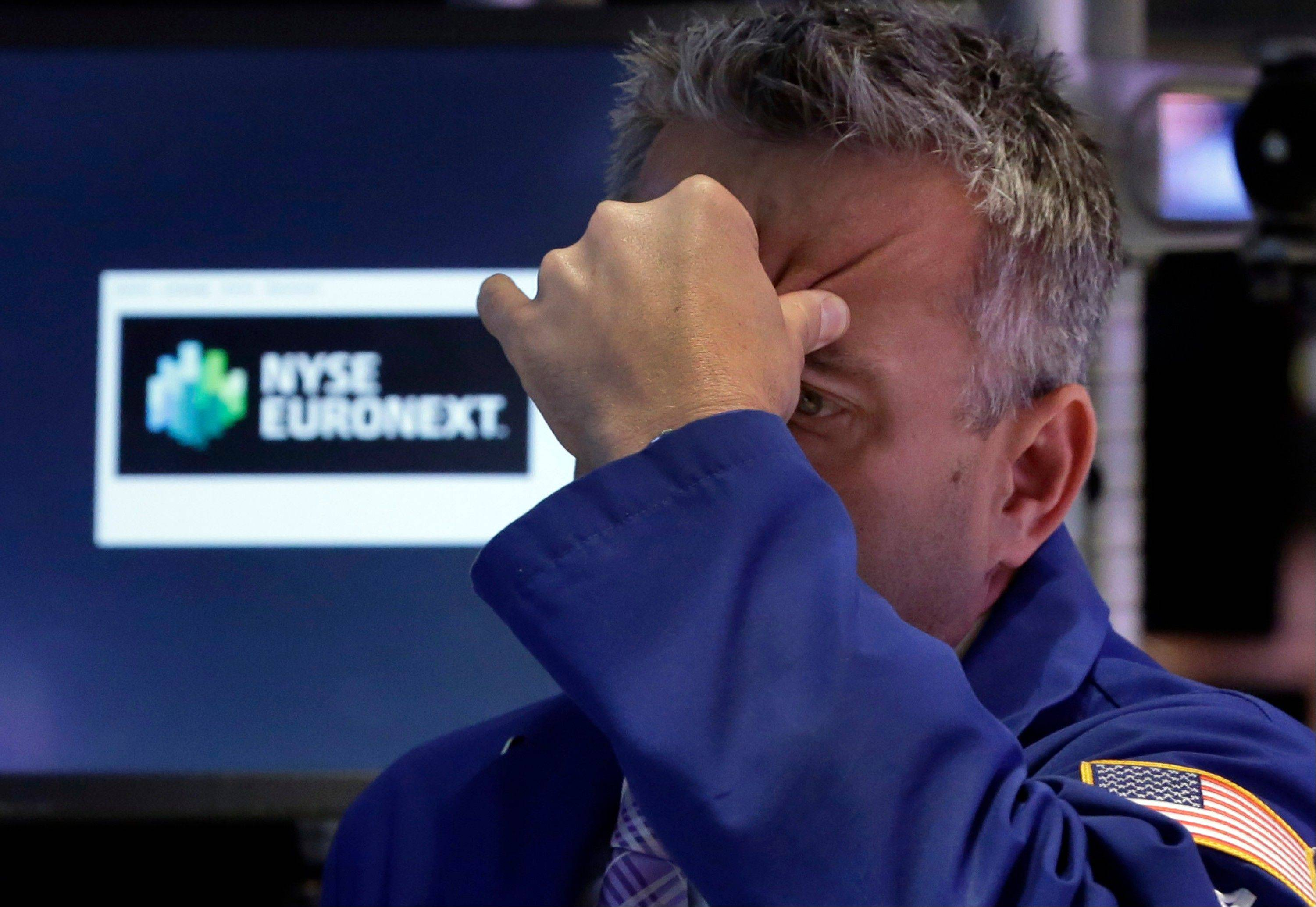 There was no letup in the flight from stocks and bonds Thursday, and the Dow Jones industrial average fell more than 300 points.